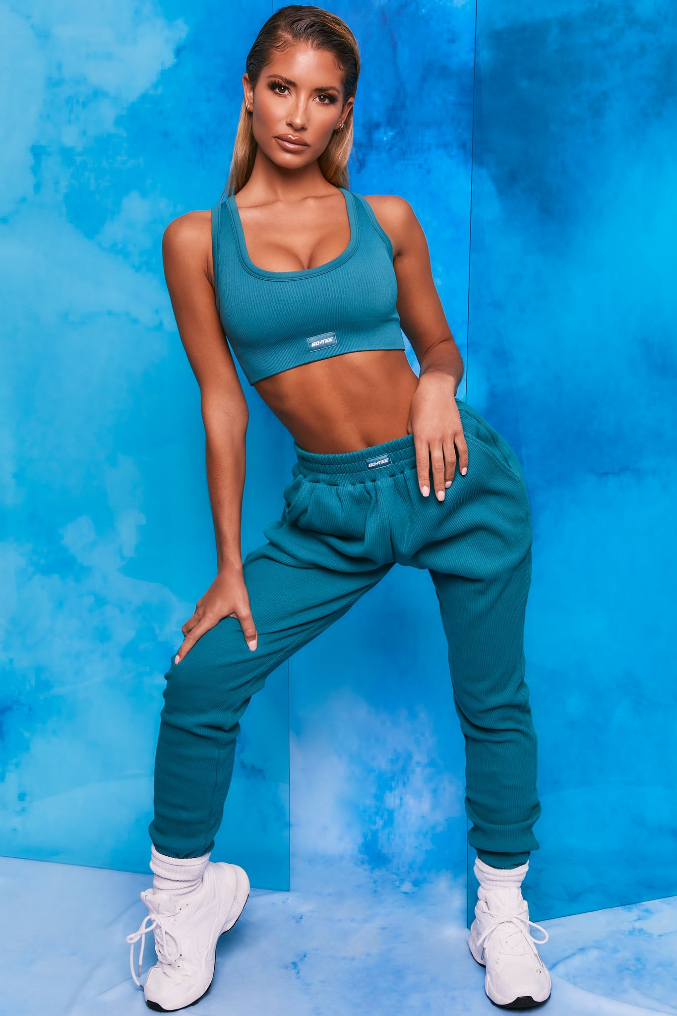 Teal ribbed full length cuffed joggers. Image 1 of 6.