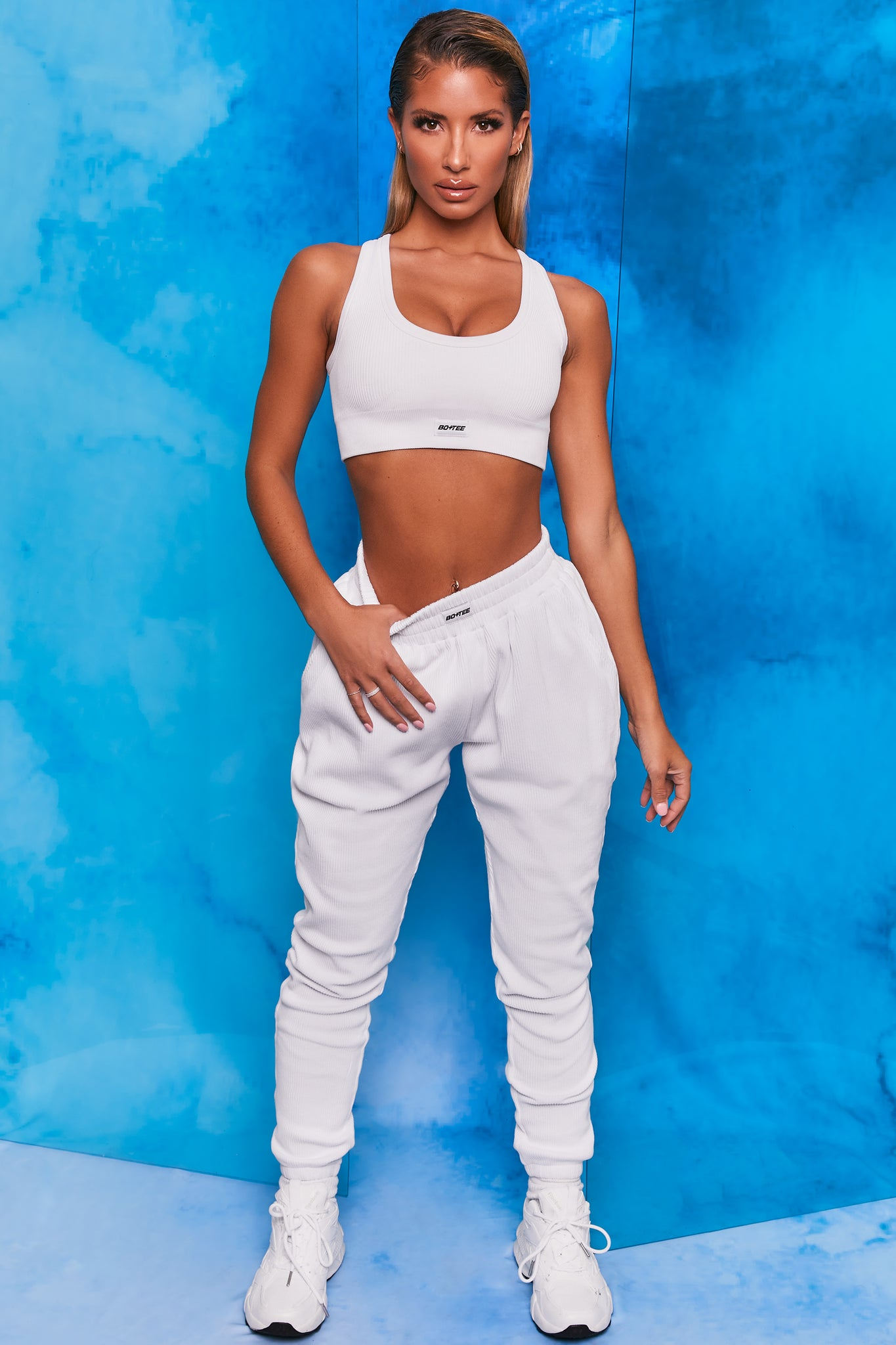 White ribbed full length cuffed joggers. Image 1 of 6.
