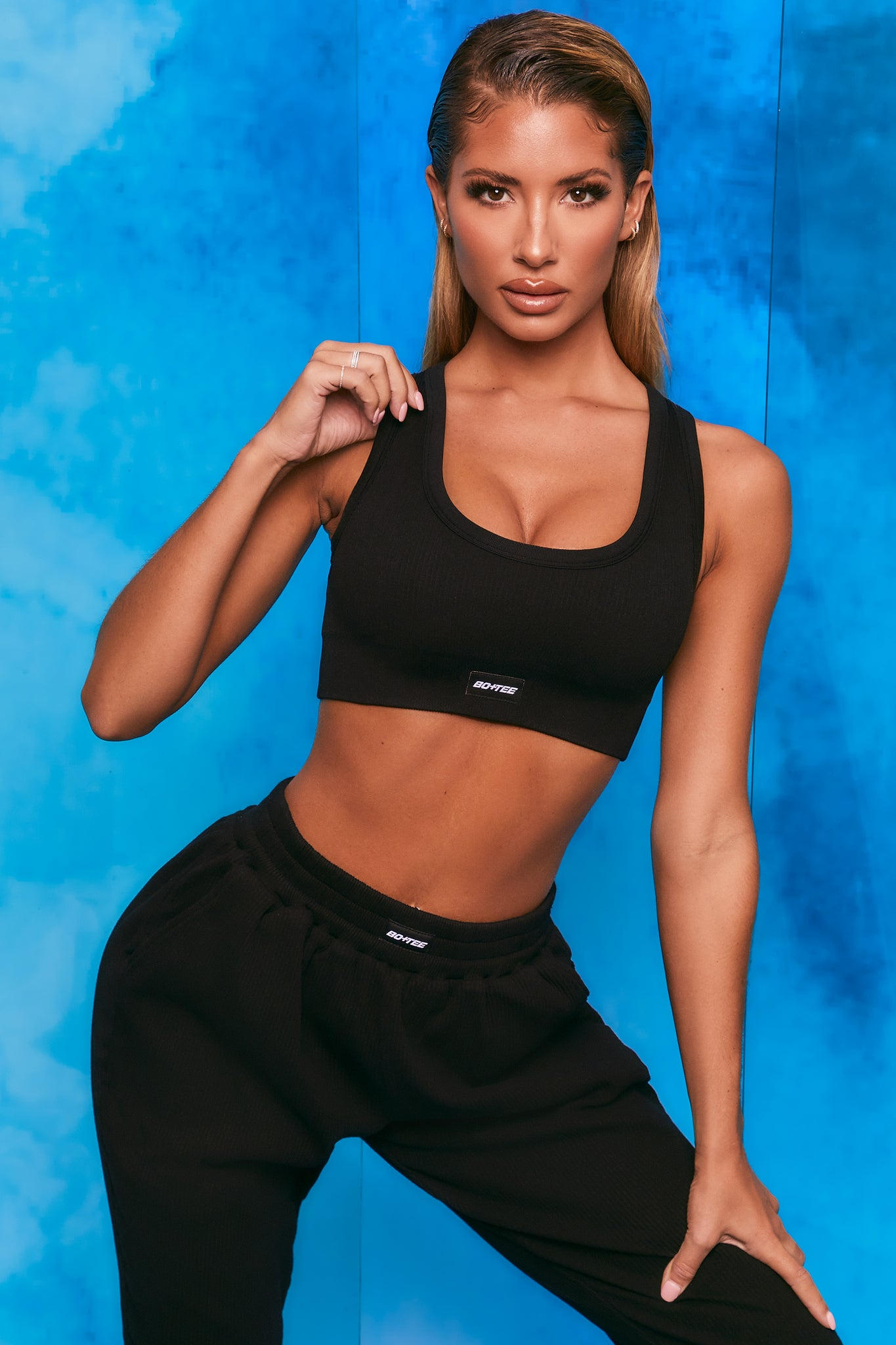 Plain black ribbed scoop neck sports bra. Image 6 of 6