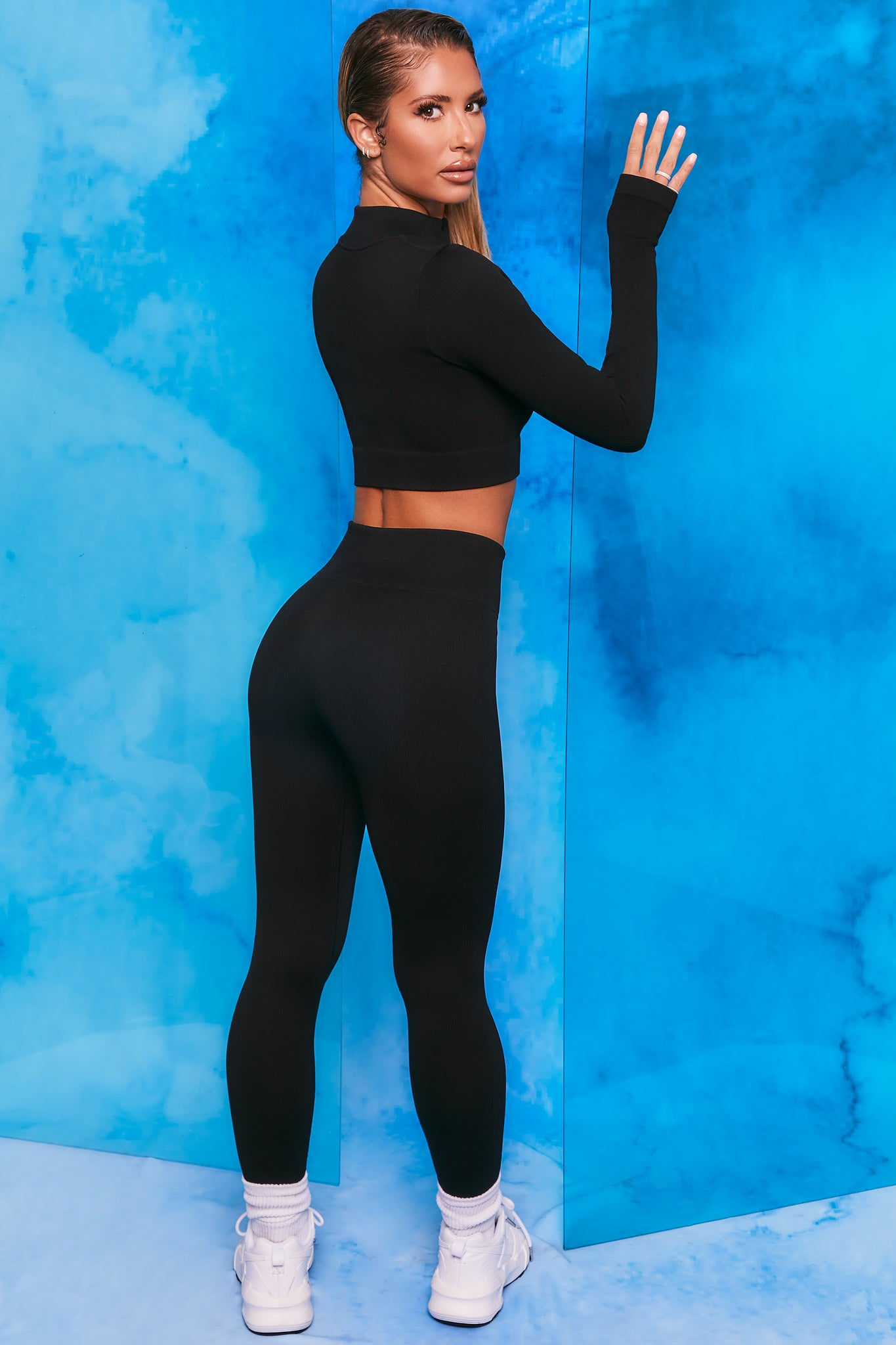 Black ribbed high waisted full length leggings. Image 3 of 6.