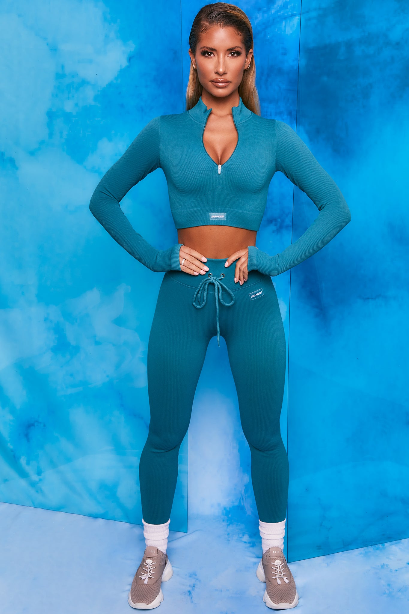 Teal ribbed high waisted full length leggings. Image 1 of 6.