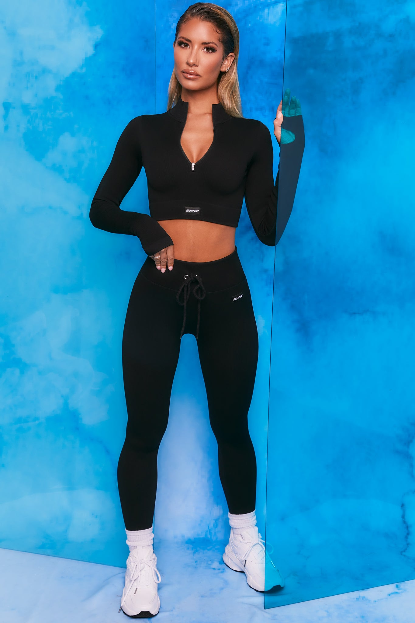 Black ribbed high waisted full length leggings. Image 1 of 6.