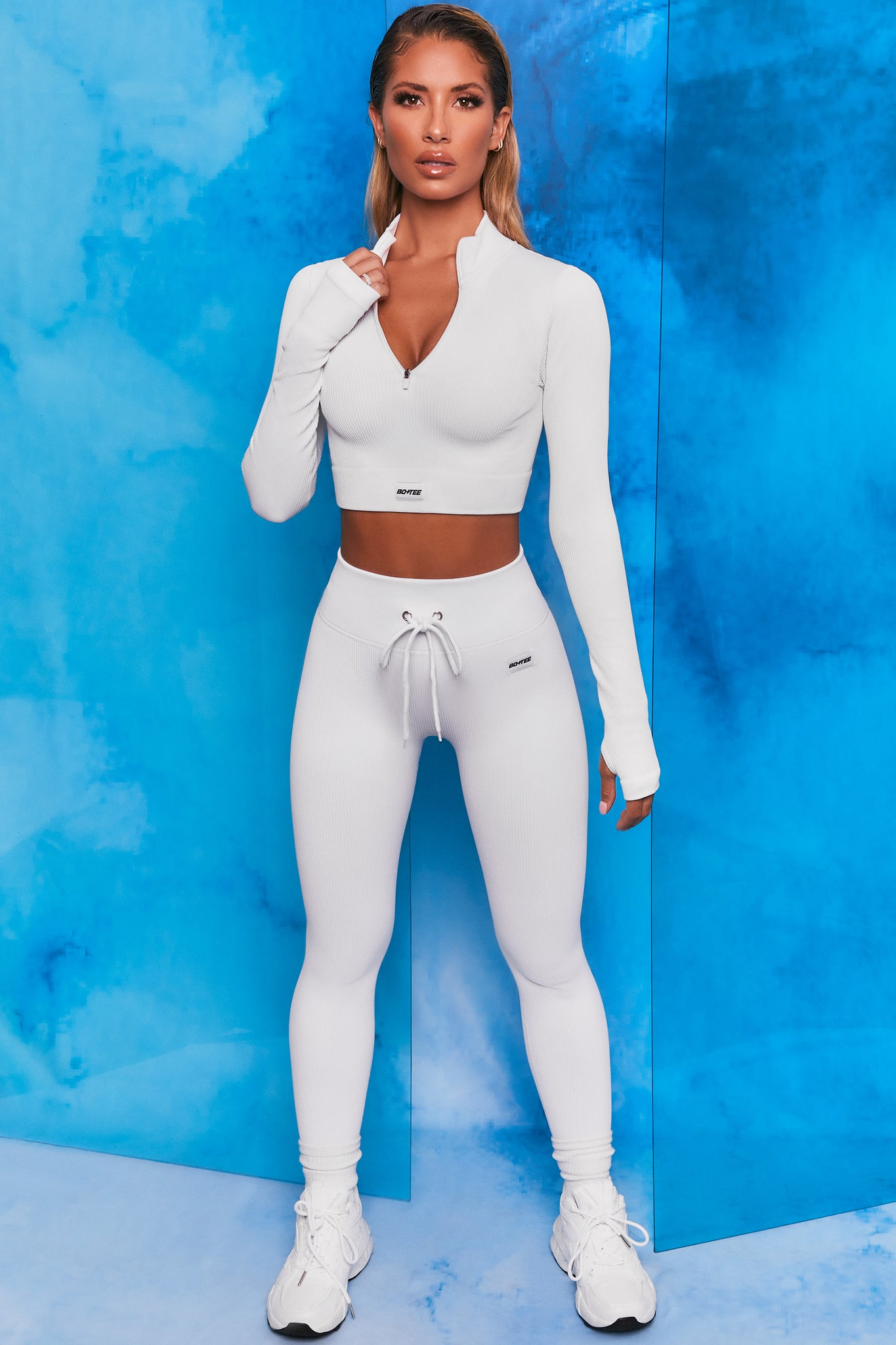 White ribbed high waisted full length leggings. Image 1 of 6.