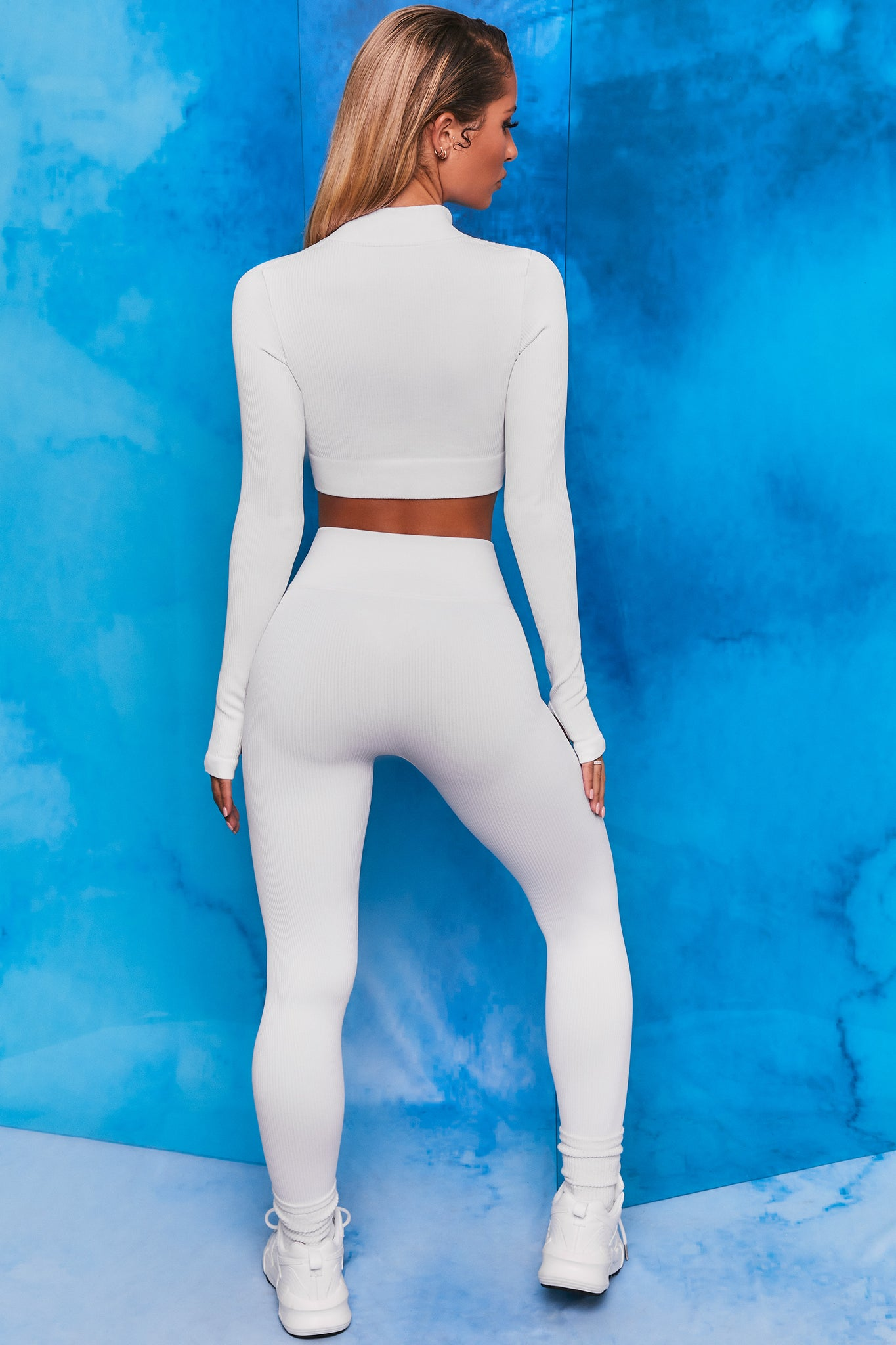 Plain white ribbed high neck crop top with zip front and long sleeves. Image 3 of 6