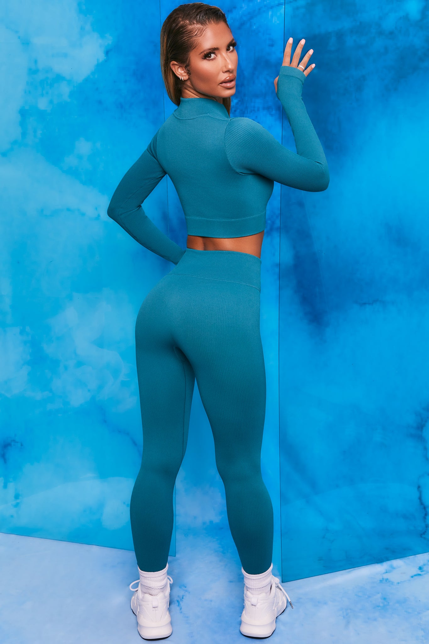 Teal ribbed high waisted full length leggings. Image 3 of 6.
