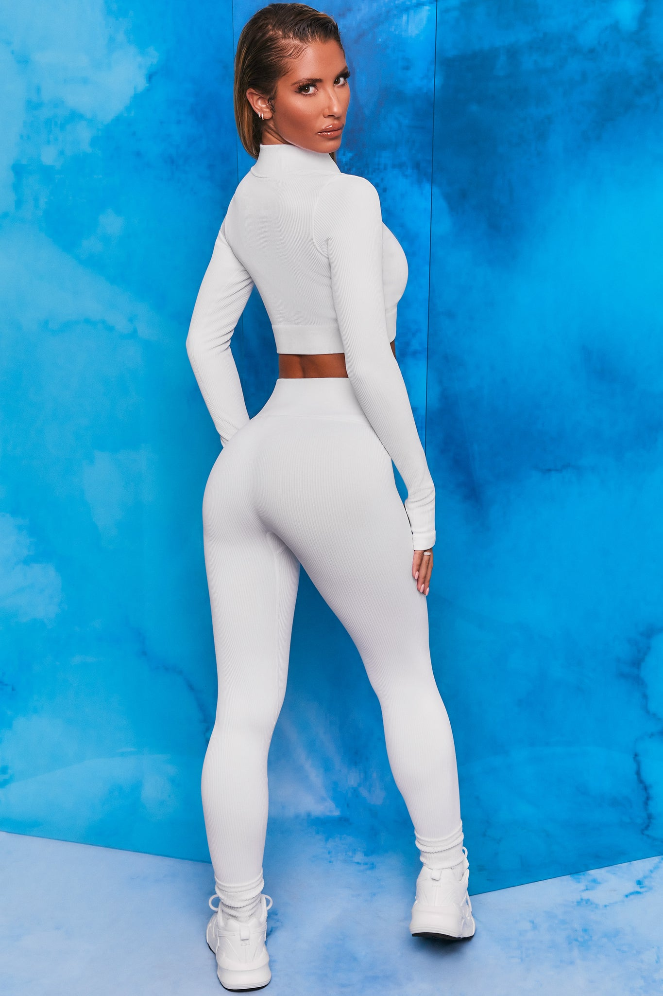 White ribbed high waisted full length leggings. Image 3 of 6.