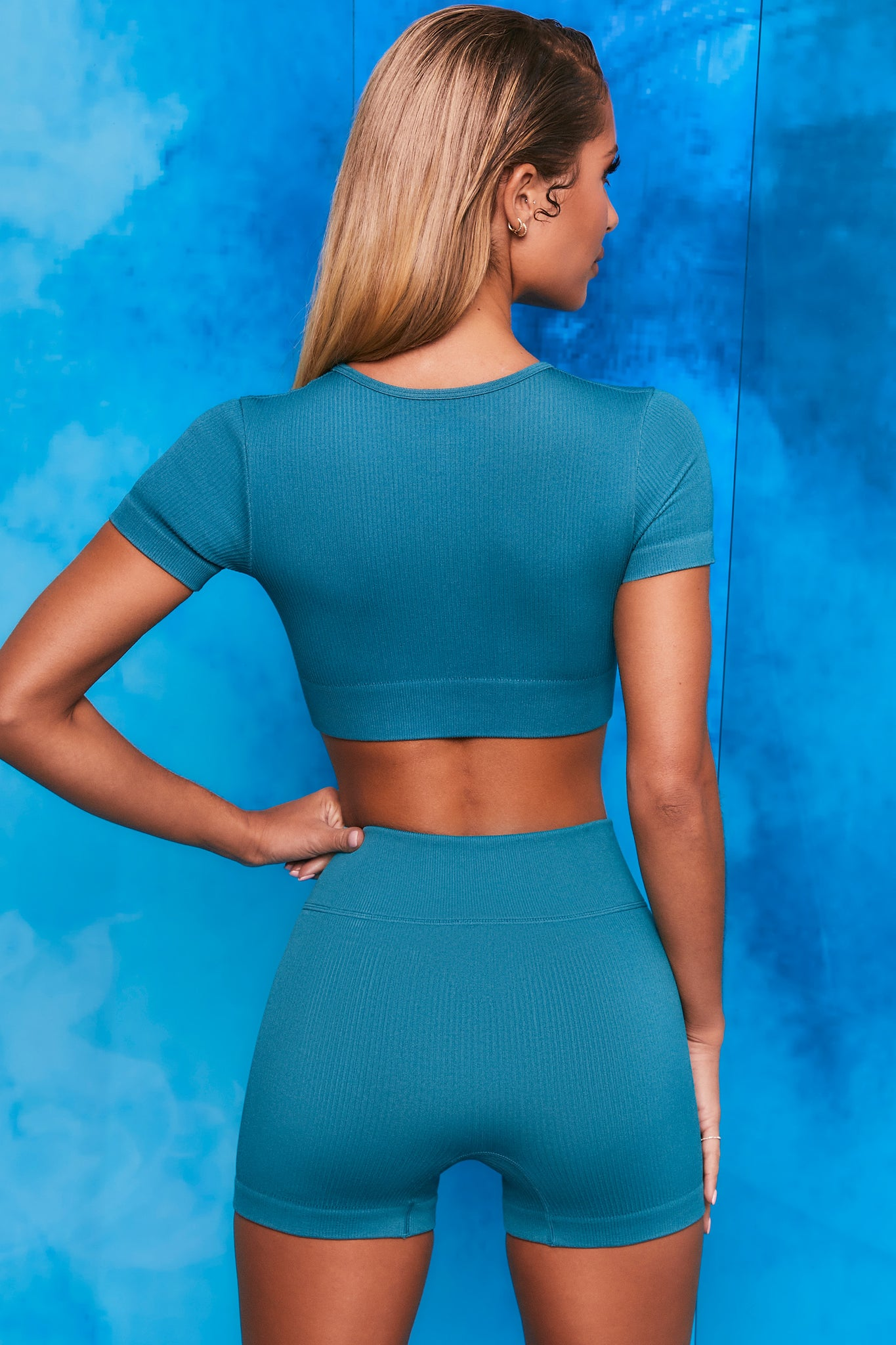 Plain teal notch neck crop top with zip front and short sleeves. Image 3 of 6