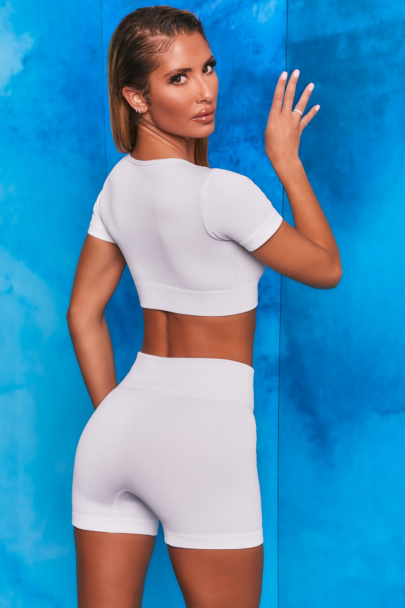 Plain white notch neck crop top with zip front and short sleeves. Image 3 of 6