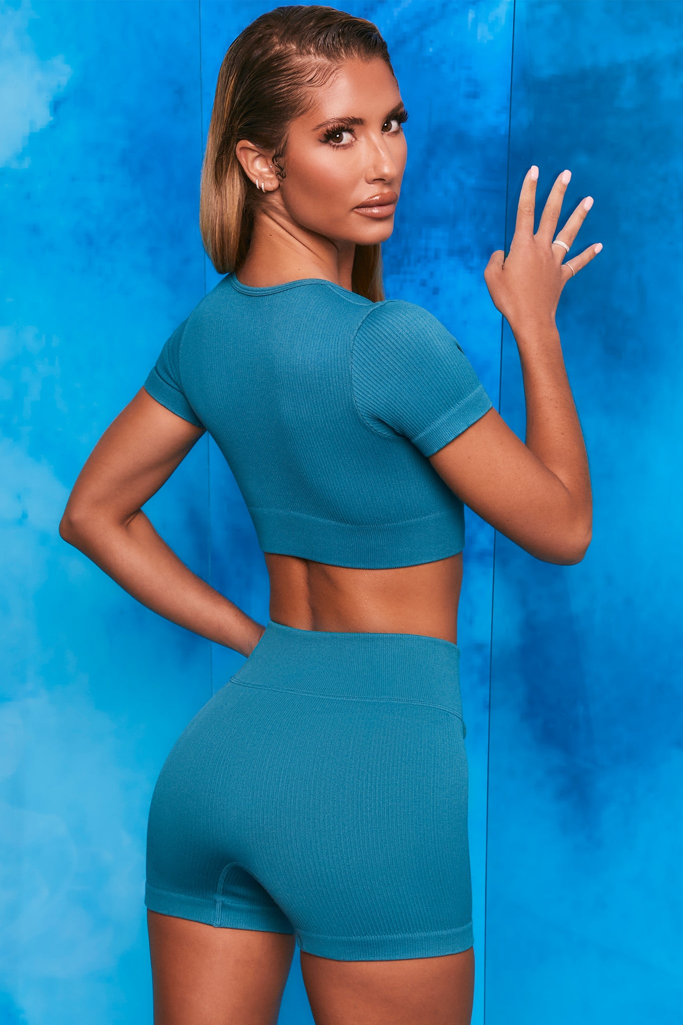 Teal ribbed mini shorts with tie front. Image 3 of 6.