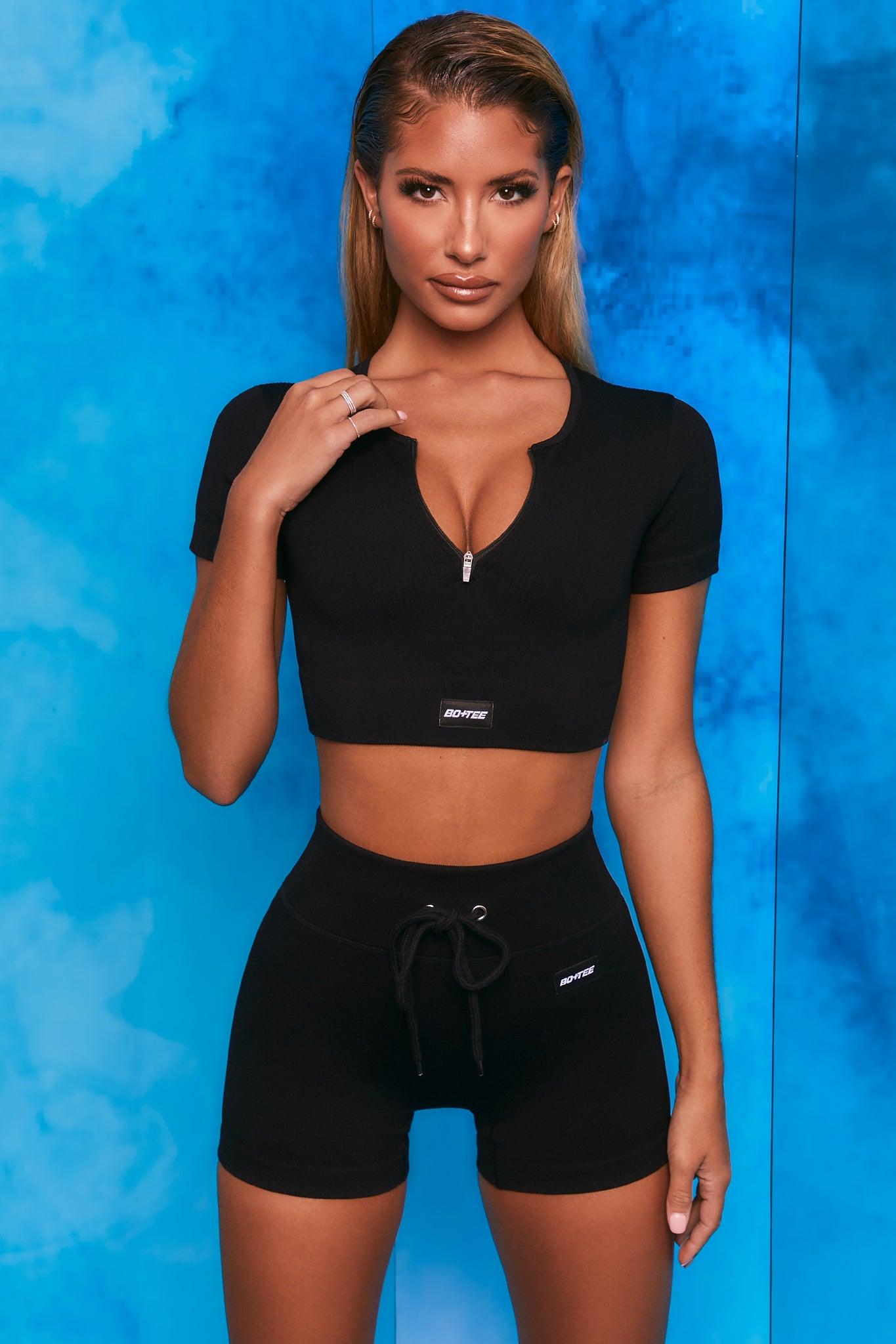 Black ribbed mini shorts with tie front. Image 1 of 6.