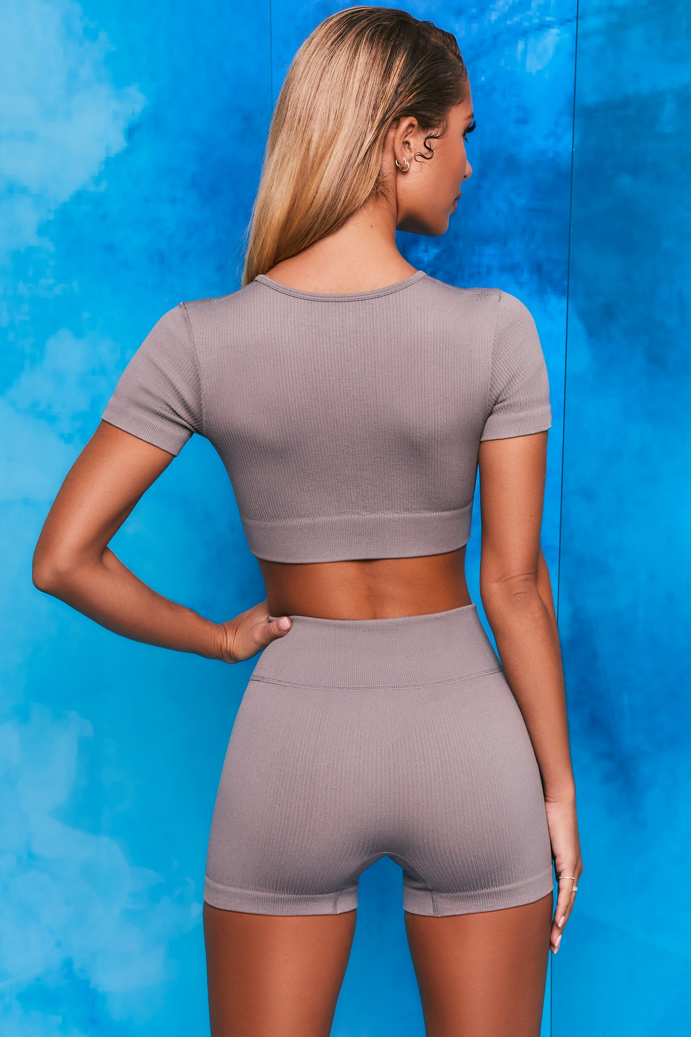 Plain grey notch neck crop top with zip front and short sleeves. Image 3 of 6
