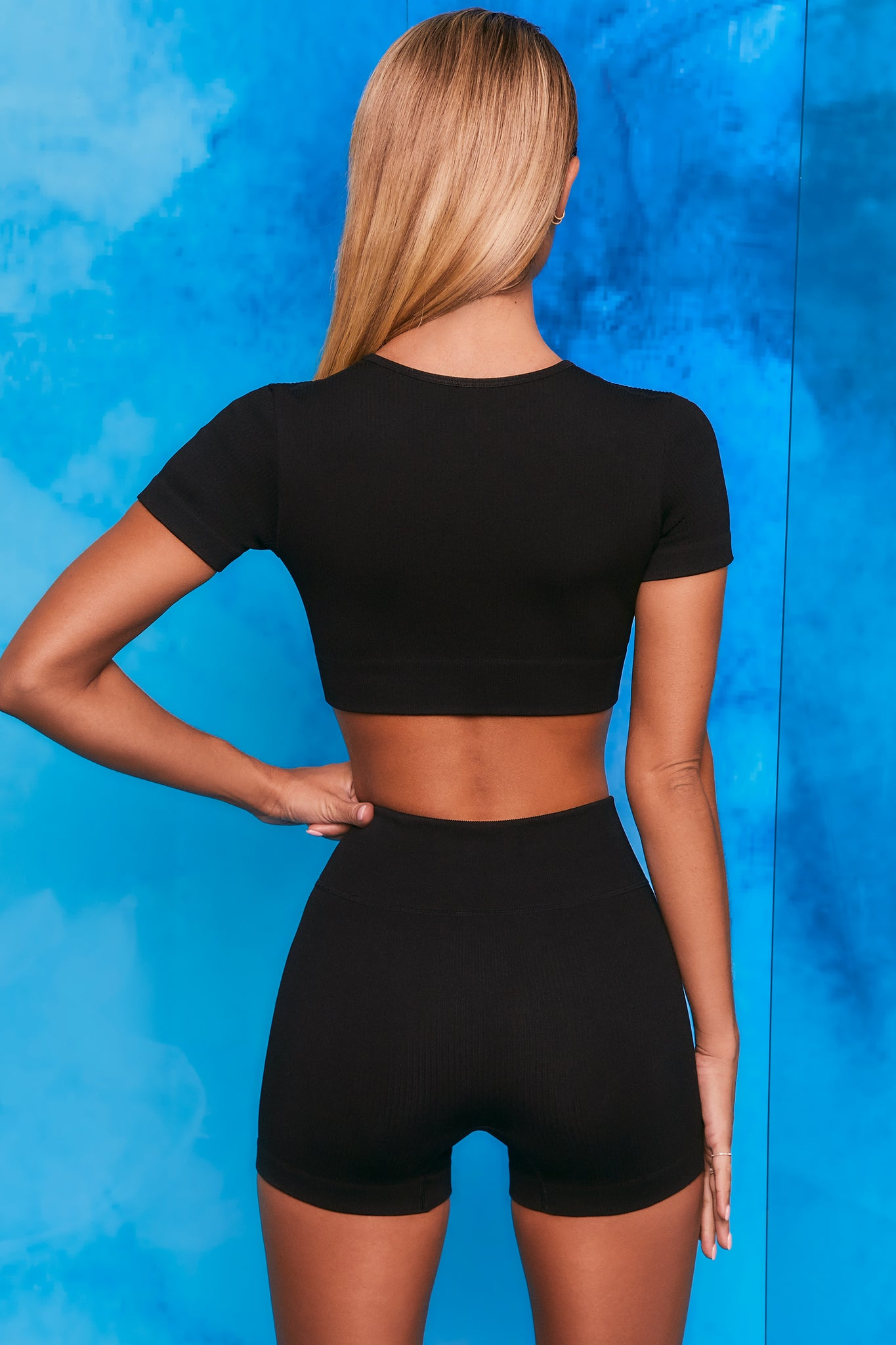 Plain black notch neck crop top with zip front and short sleeves. Image 3 of 6