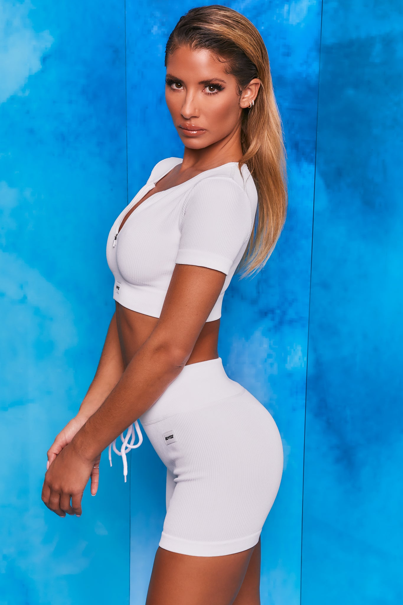 Plain white notch neck crop top with zip front and short sleeves. Image 2 of 6