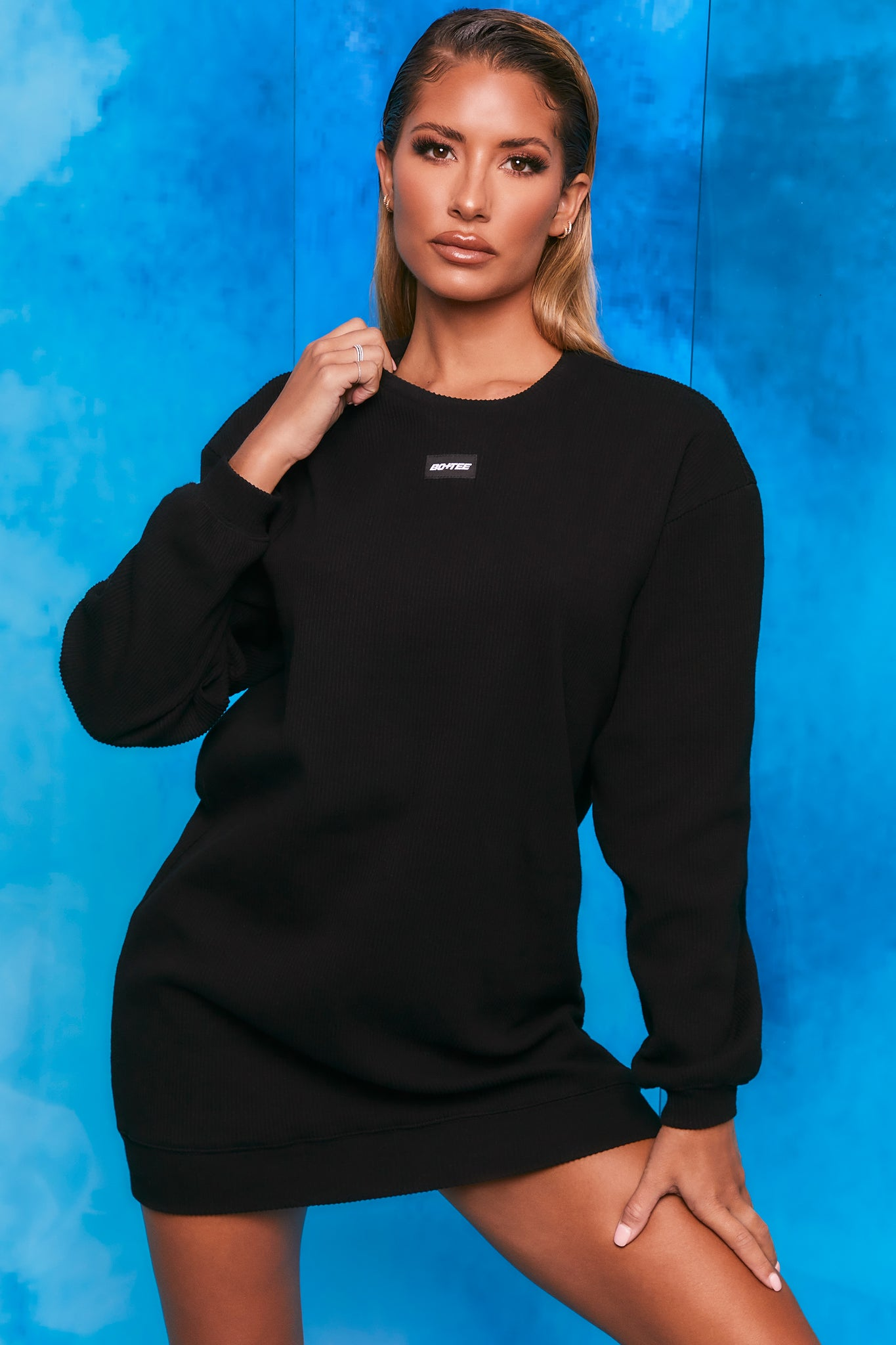 Plain black ribbed oversized sweatshirt with long sleeves. Image 1 of 6.