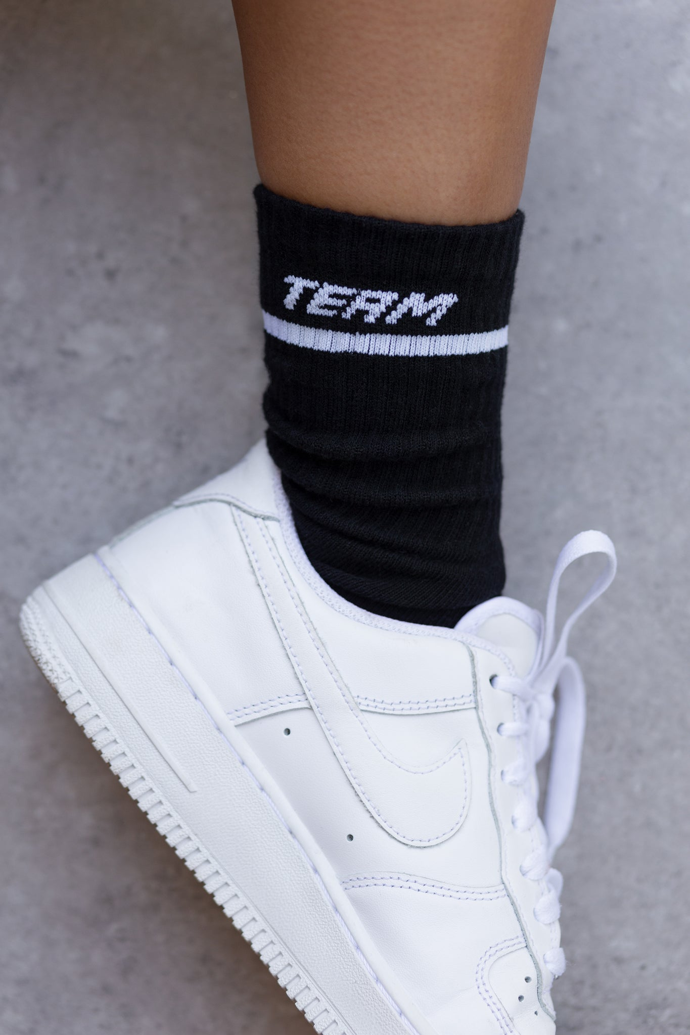 Black ribbed ankle socks with stitched logo branding and stripe edge. Image 4 of 6.