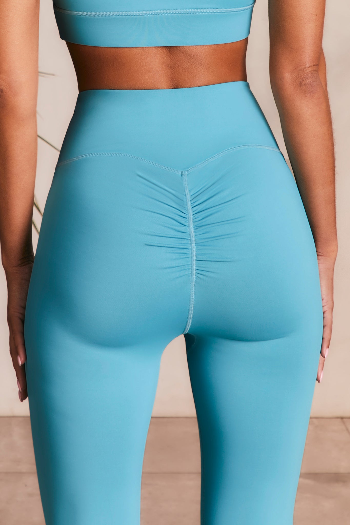 Slinky leggings in aqua with ruched rear. Image 3 of 6