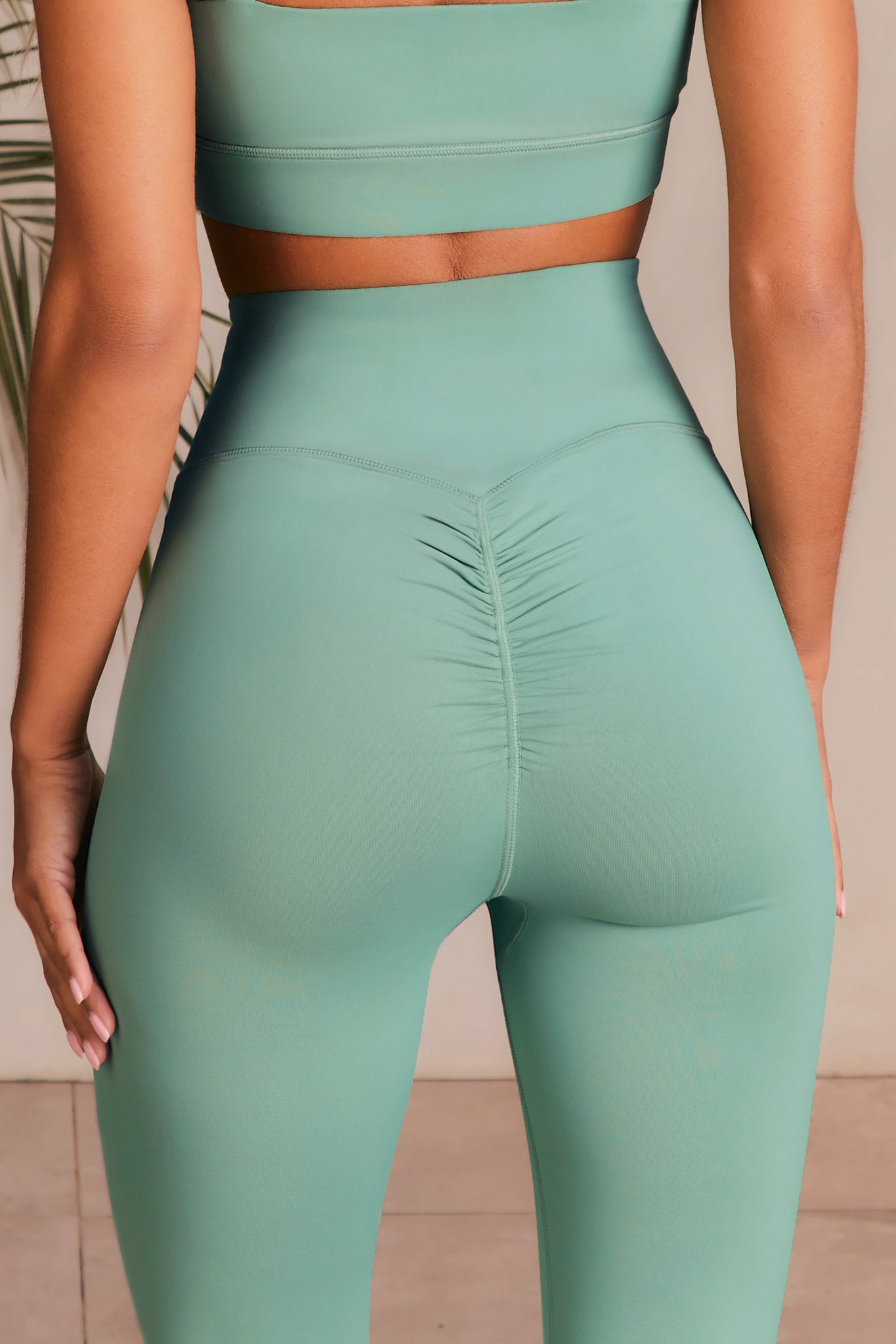 Slinky leggings in green with ruched rear. Image 3 of 6