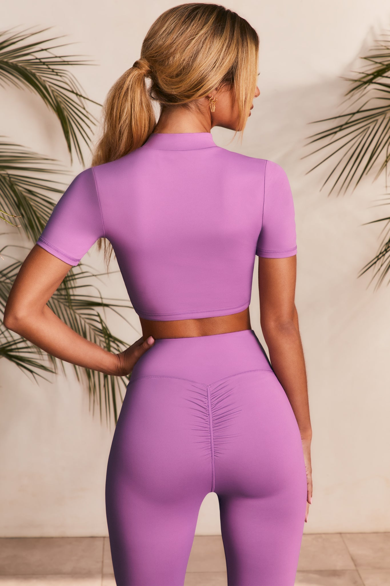 High neck crop top in purple with short sleeves. Image 3 of 6.