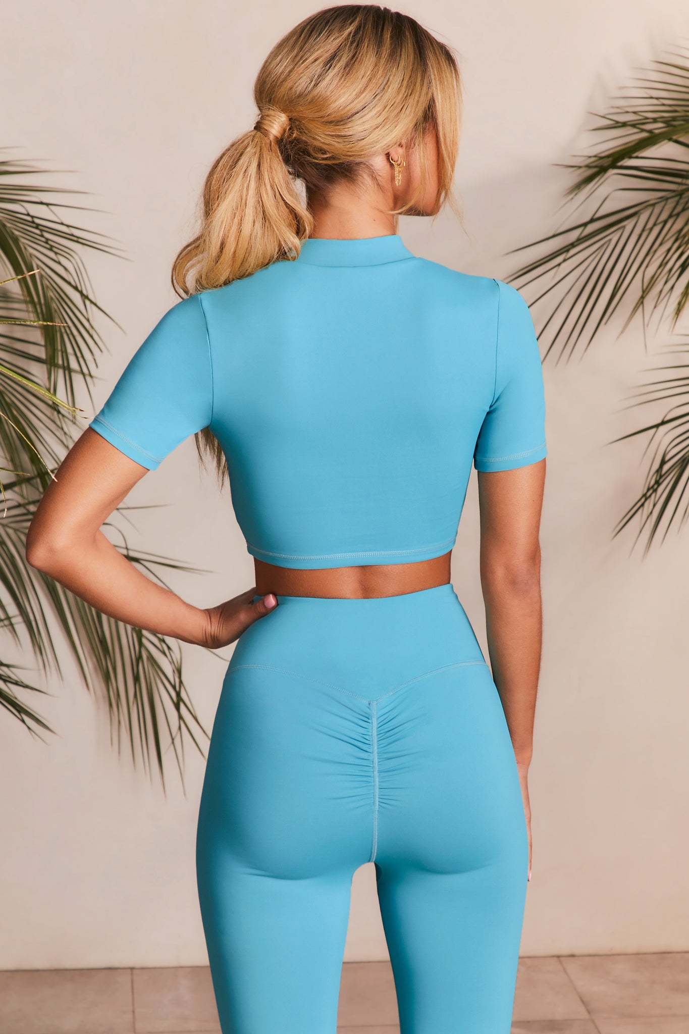 High neck crop top in aqua with short sleeves. Image 3 of 6.