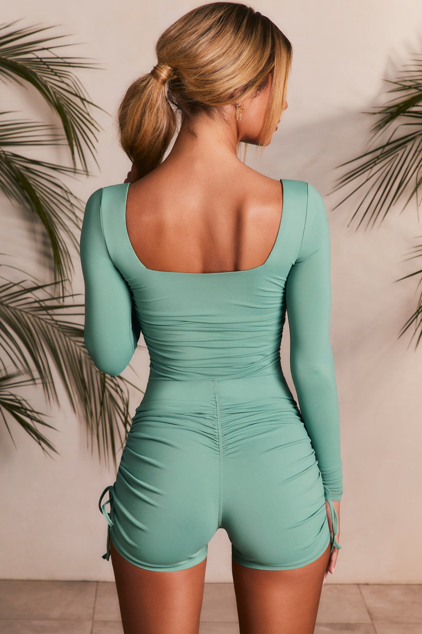 Slinky long sleeve unitard in green with square back and ruched rear. Image 4 of 6.