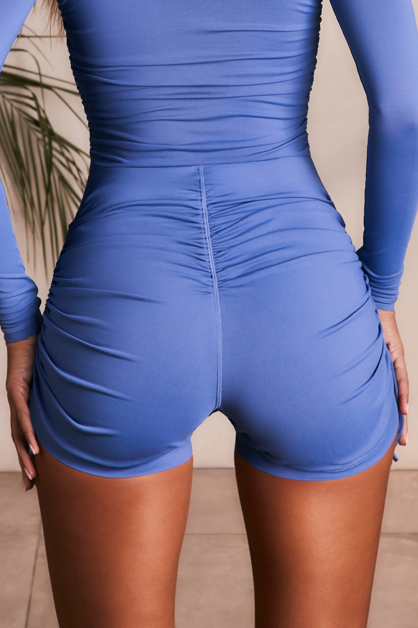 Slinky long sleeve unitard in blue violet with ruched rear. Image 3 of 6.