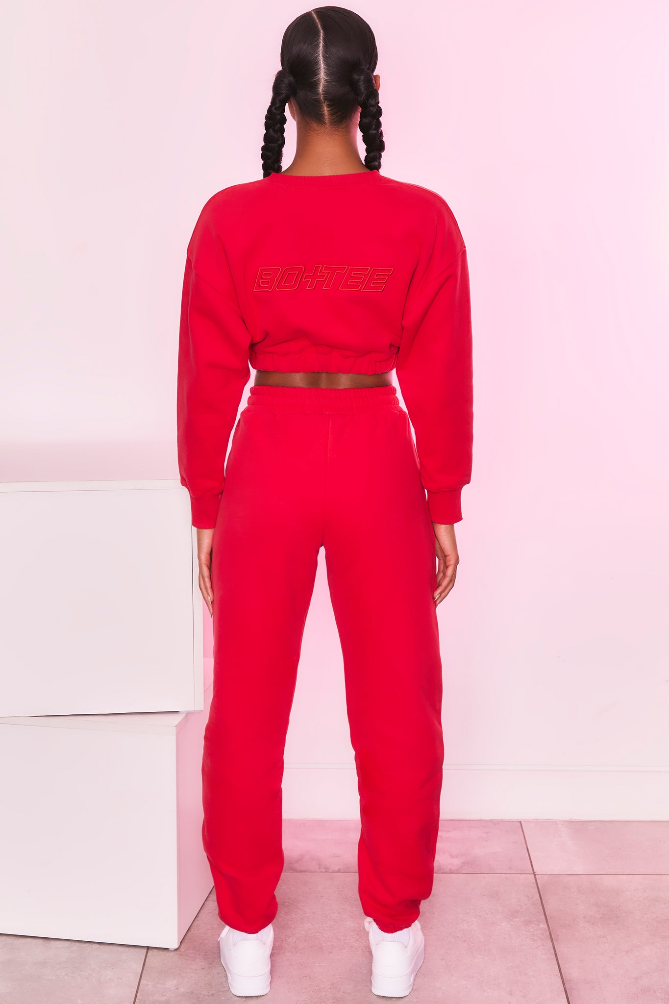 Long sleeve cropped jumper in red with logo branding. Image 3 of 6.