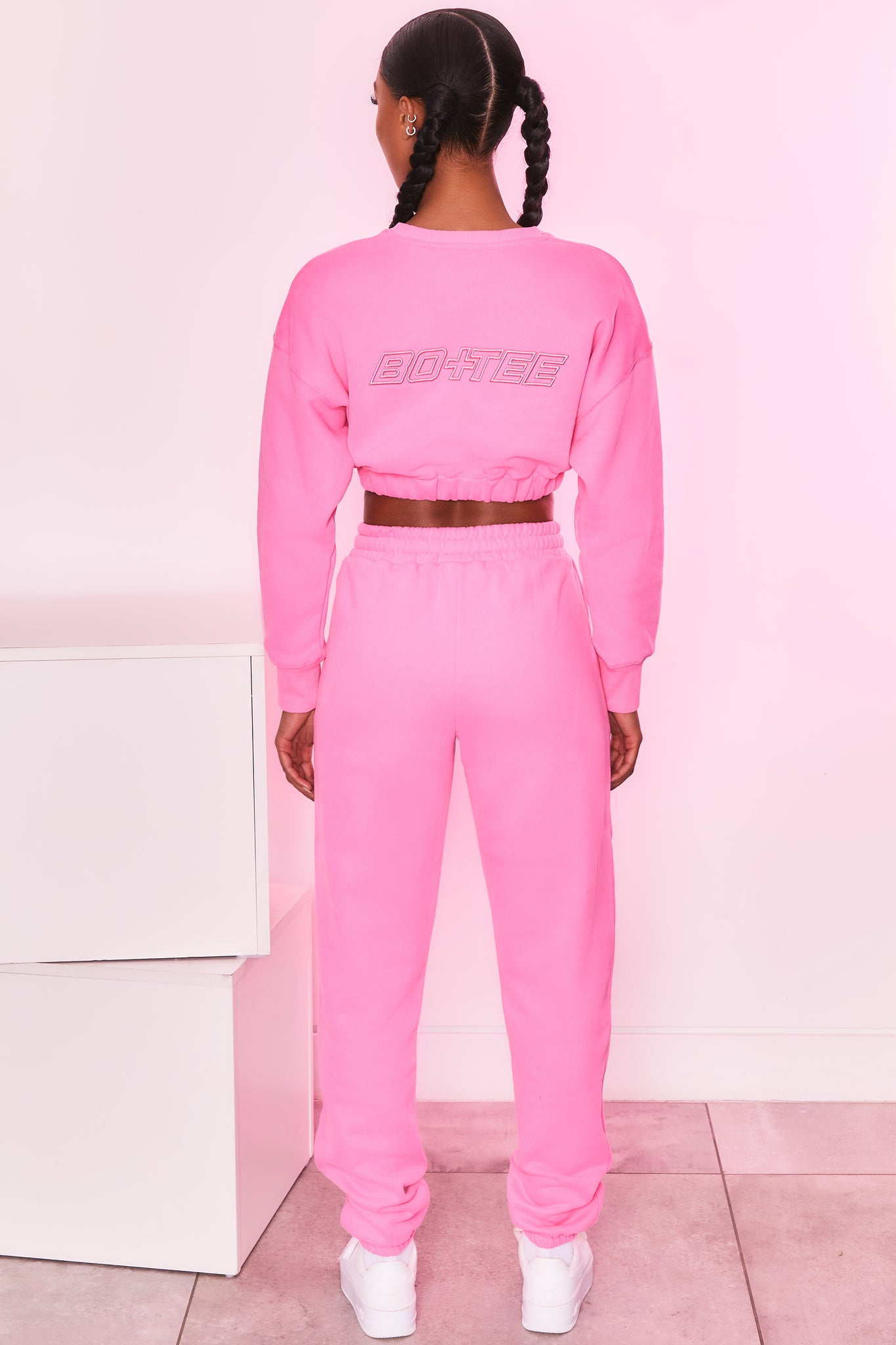 Long sleeve cropped jumper in candy pink with logo branding. Image 3 of 6.