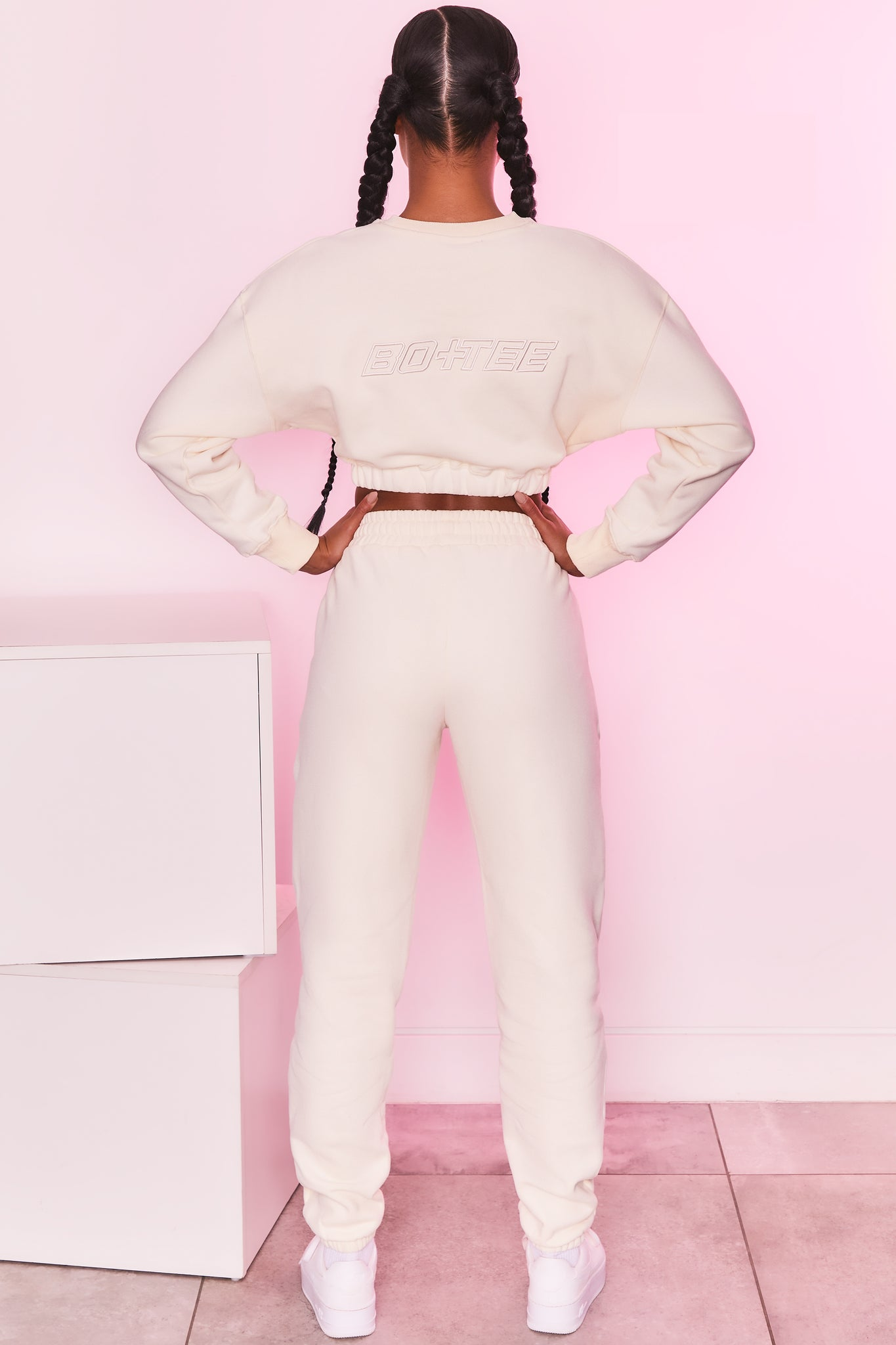 Long sleeve cropped jumper in ivory with logo branding. Image 3 of 6.