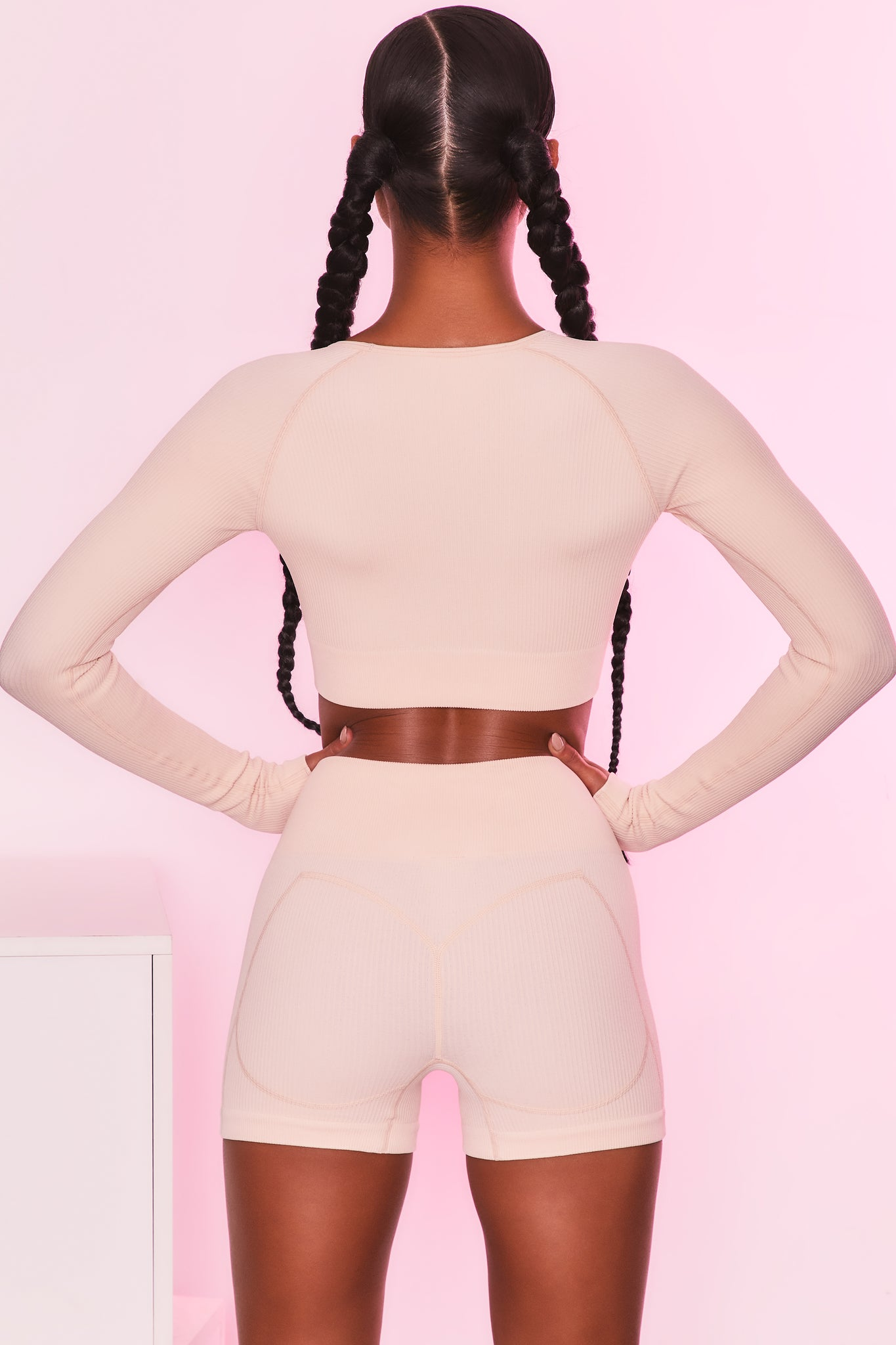 Ribbed long sleeve crop top in cream. Image 3 of 6.