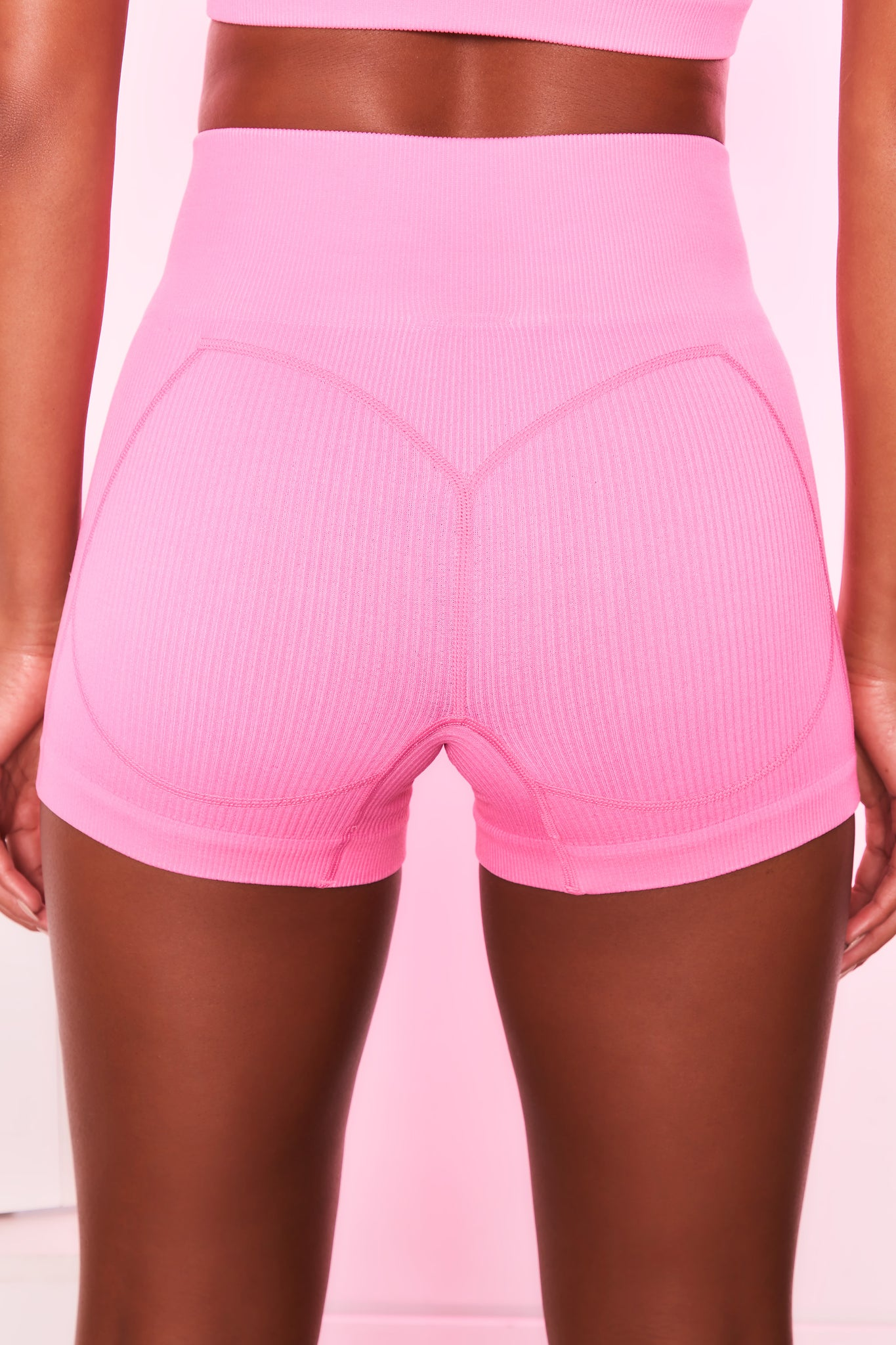 High waisted ribbed mini shorts in candy pink with seam detailing. Image 3 of 6.