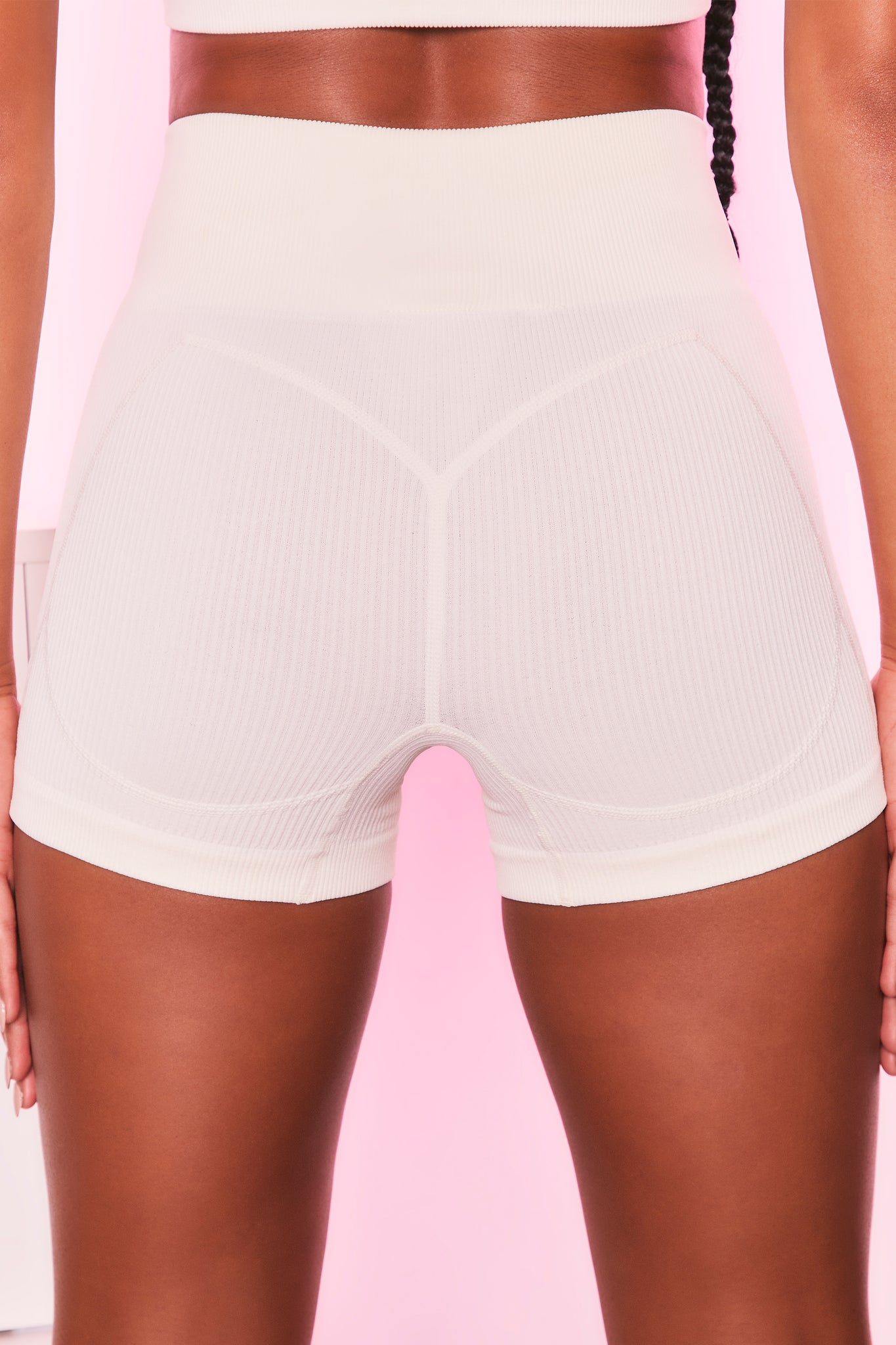 High waisted ribbed mini shorts in ivory with seam detailing. Image 3 of 6.