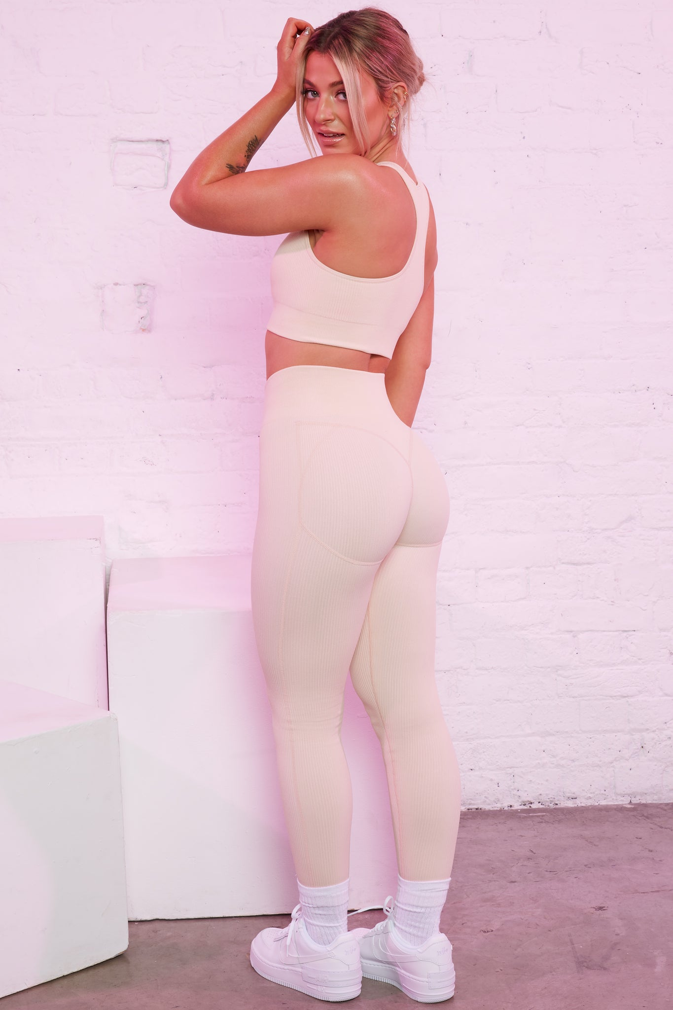 High waisted ribbed leggings in cream with central logo branding. Image 4 of 6.