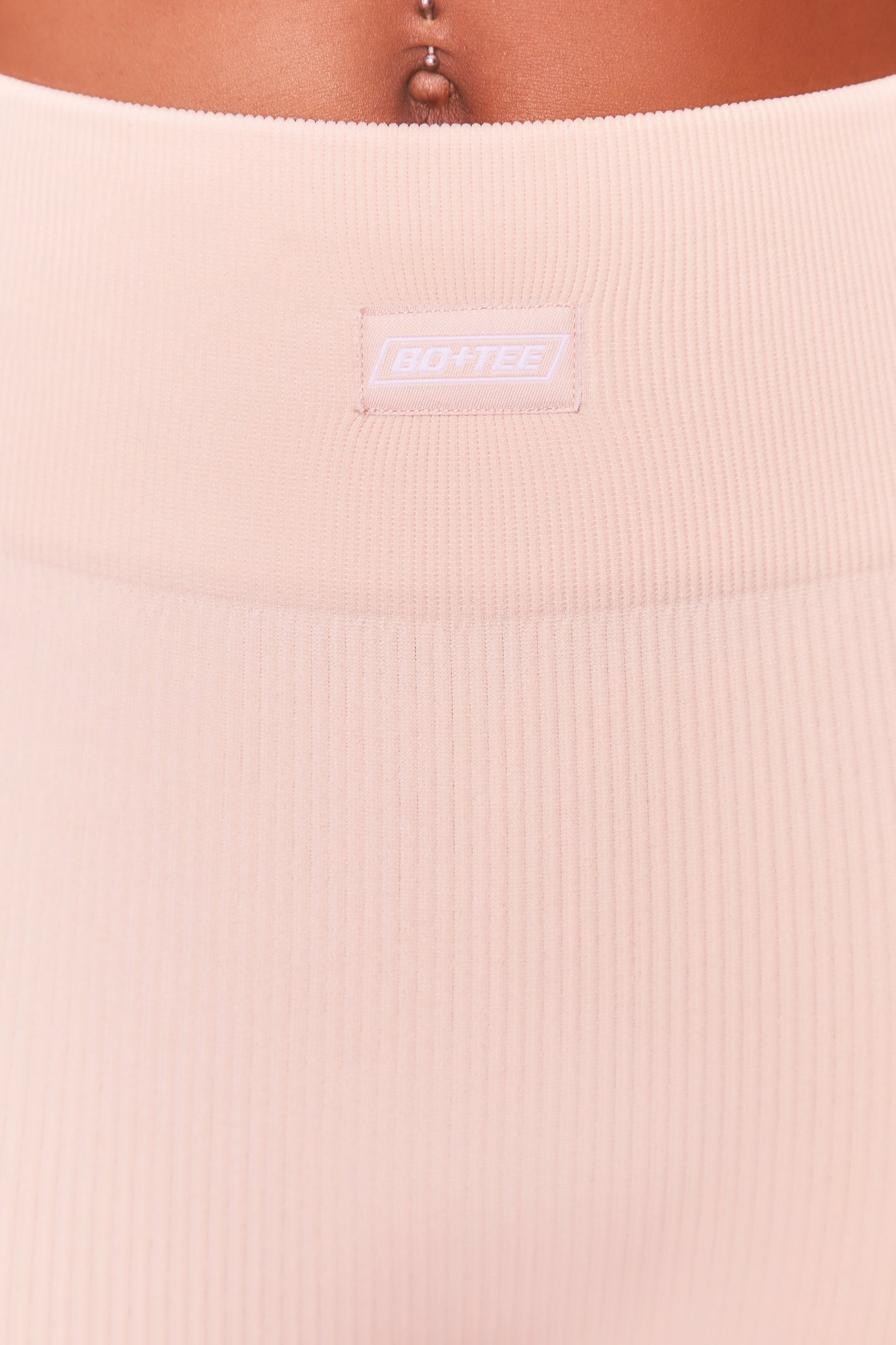 High waisted ribbed leggings in cream with central logo branding. Image 5 of 6.
