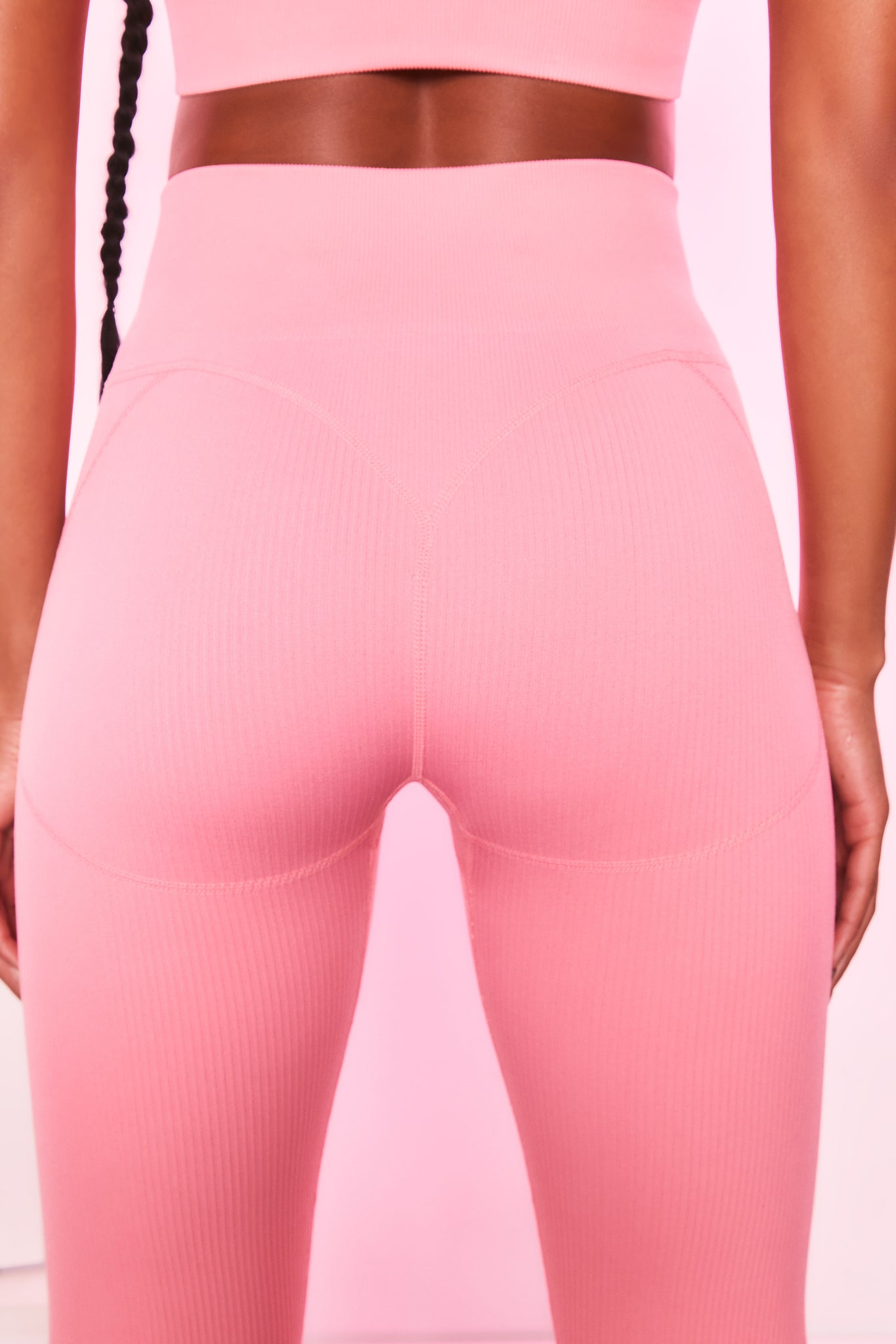 High waisted ribbed leggings in coral with seam detailing. Image 3 of 6.