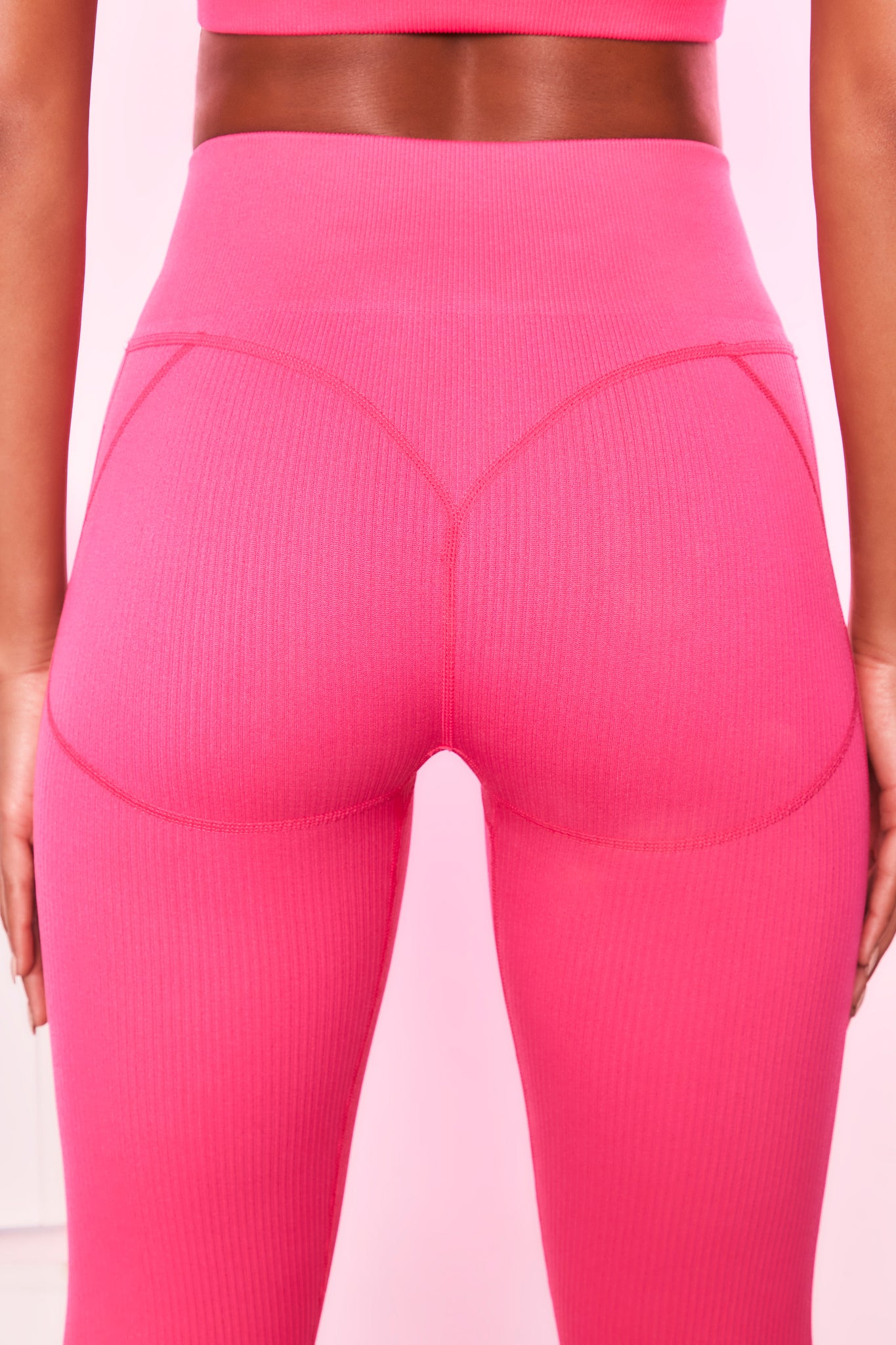 High waisted ribbed leggings in hot pink with seam detailing. Image 3 of 6.