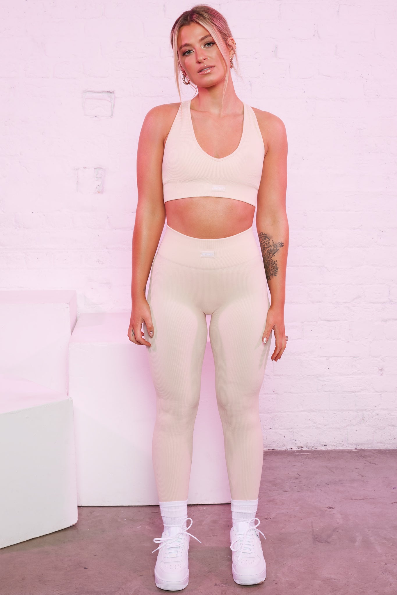 High waisted ribbed leggings in cream with central logo branding. Image 2 of 6.