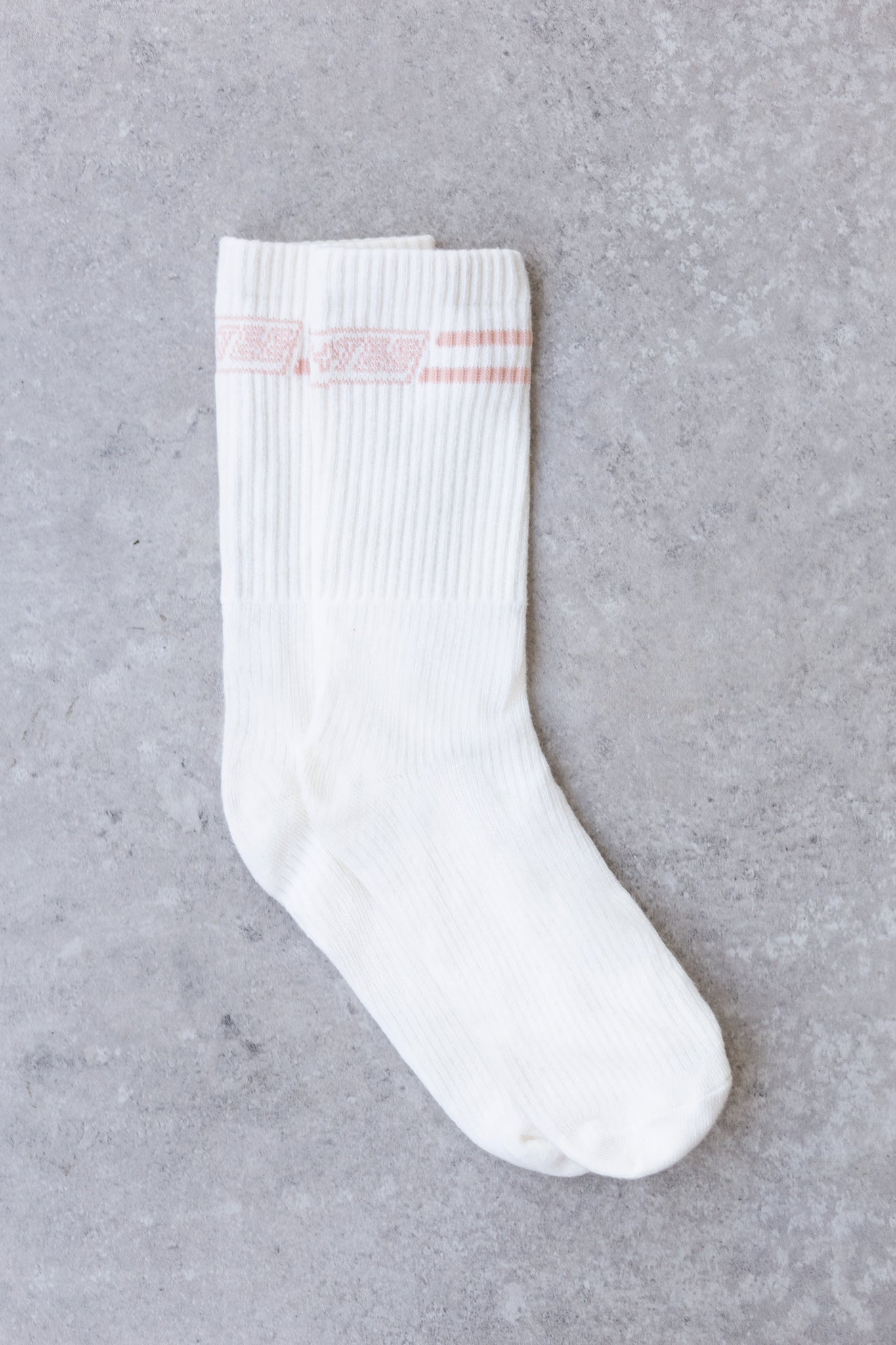 Ribbed ankle socks in ivory with logo branding on the back. Image 3 of 4.