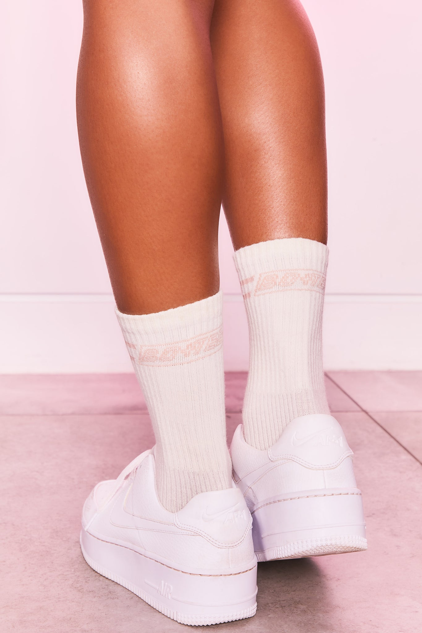 Ribbed ankle socks in ivory with logo branding on the back. Image 1 of 4.
