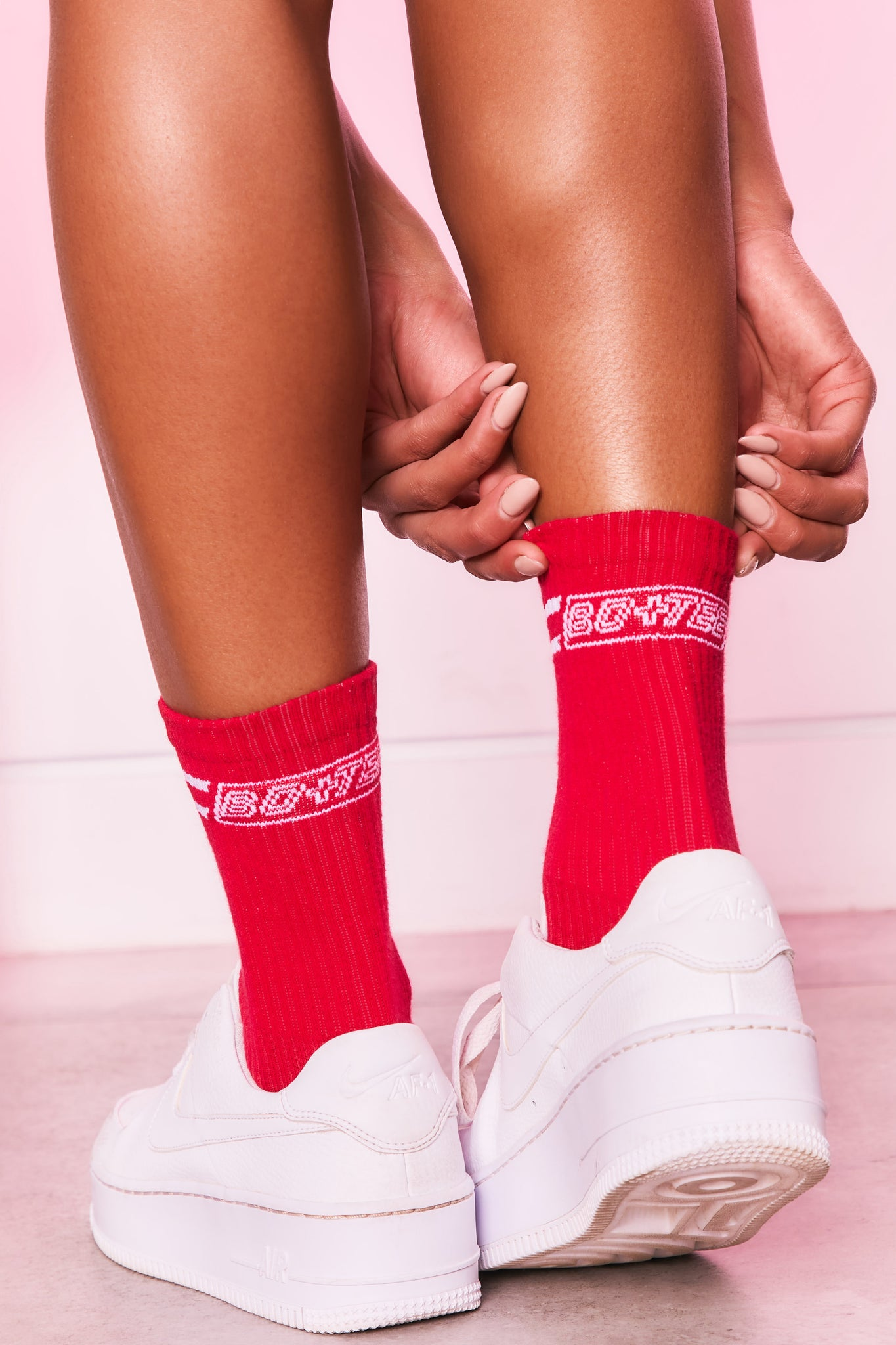 Ribbed ankle socks in red with logo branding on the back. Image 1 of 4.