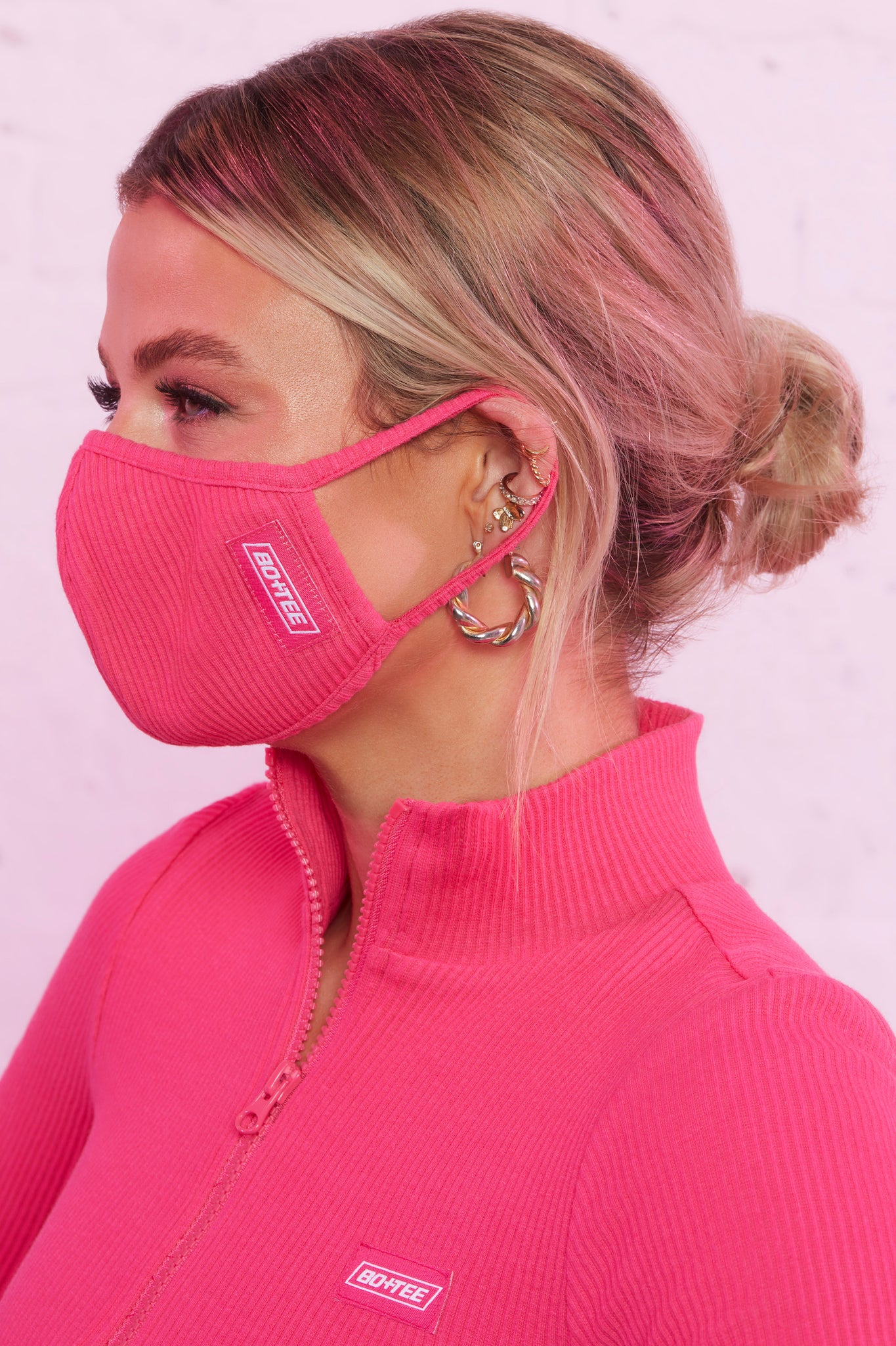 Ribbed face covering in hot pink. Image 3 of 3.