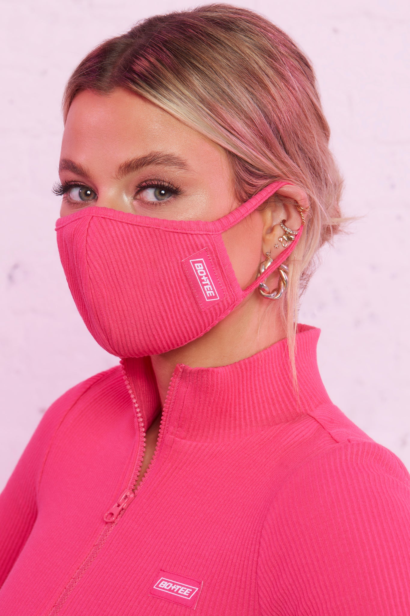 Ribbed face covering in hot pink. Image 1 of 3.