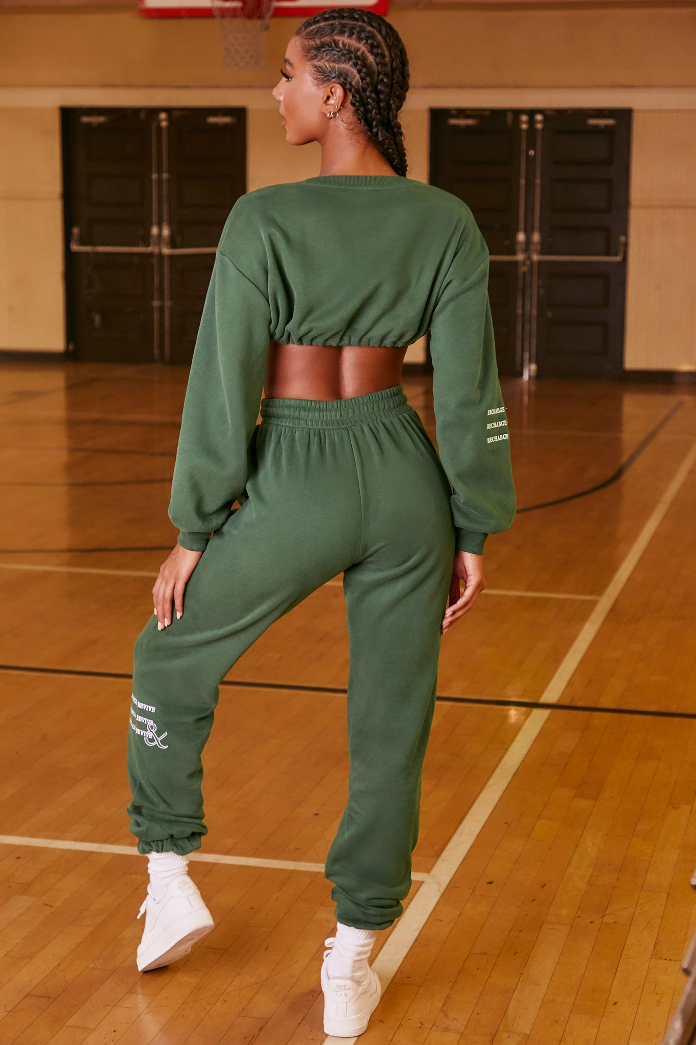 Green long sleeve cropped sweatshirt with drawstring tie hem. Image 3 of 6.