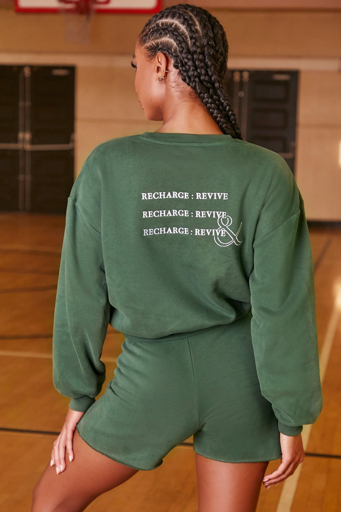 Green oversized sweatshirt with long sleeves, crew neckline and logo branding on the back. Image 3 of 6.