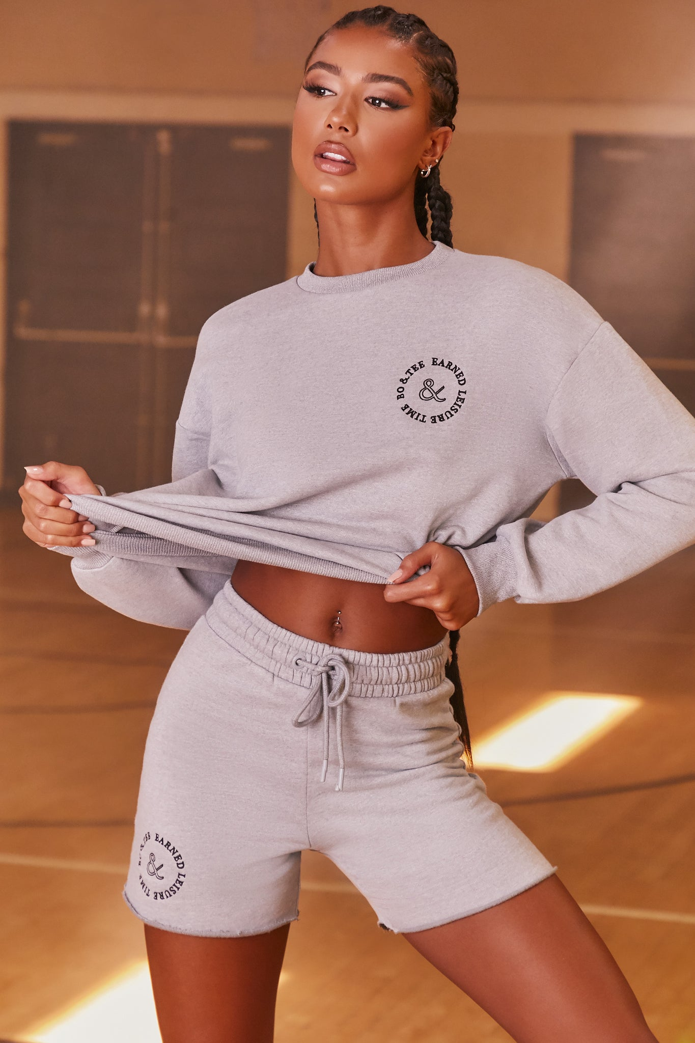 Grey oversized sweat shorts with high elasticated waist and logo branding. Image 1 of 6.
