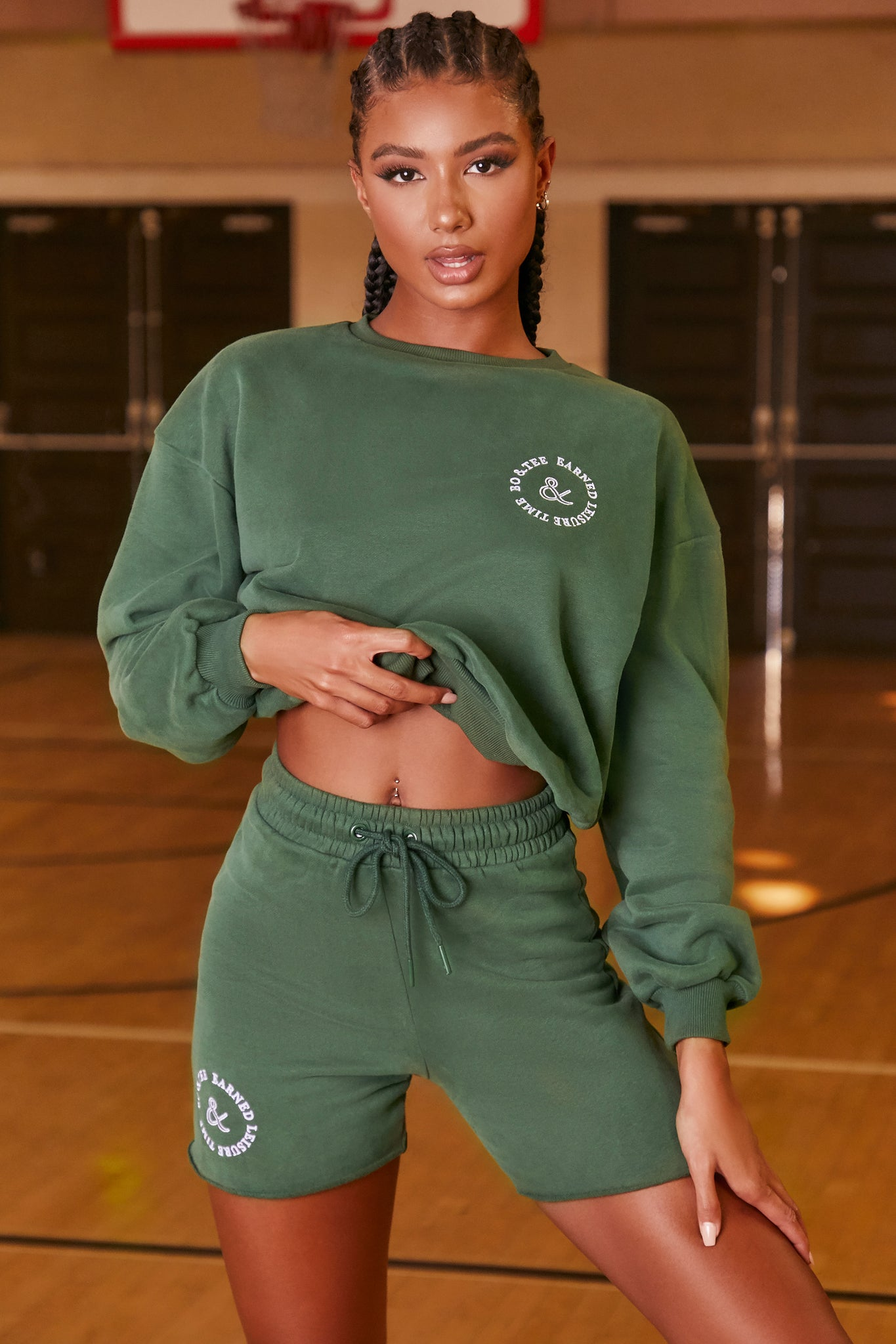 Green oversized sweat shorts with high elasticated waist and logo branding. Image 1 of 6.