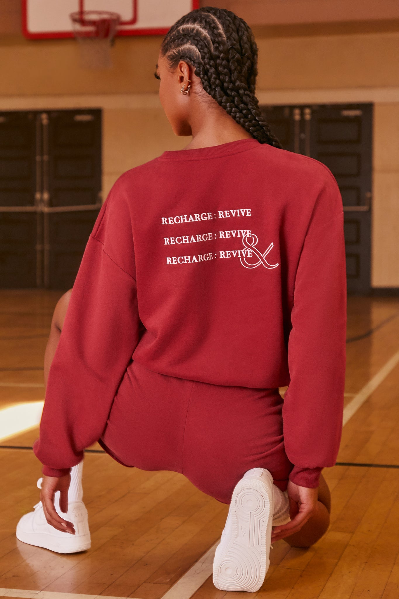 Burgundy oversized sweatshirt with long sleeves, crew neckline and logo branding on the back. Image 3 of 6.