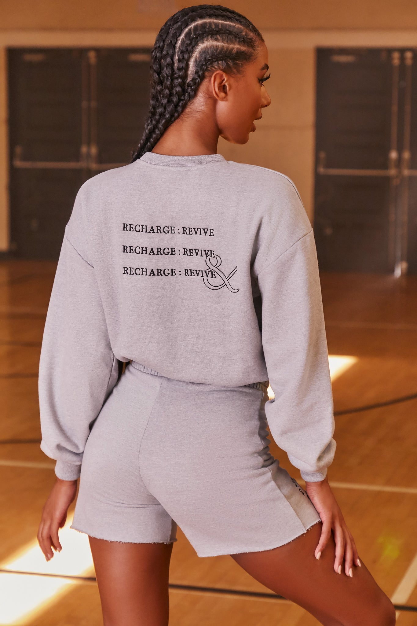 Grey oversized sweatshirt with long sleeves, crew neckline and logo branding on the back. Image 3 of 6.