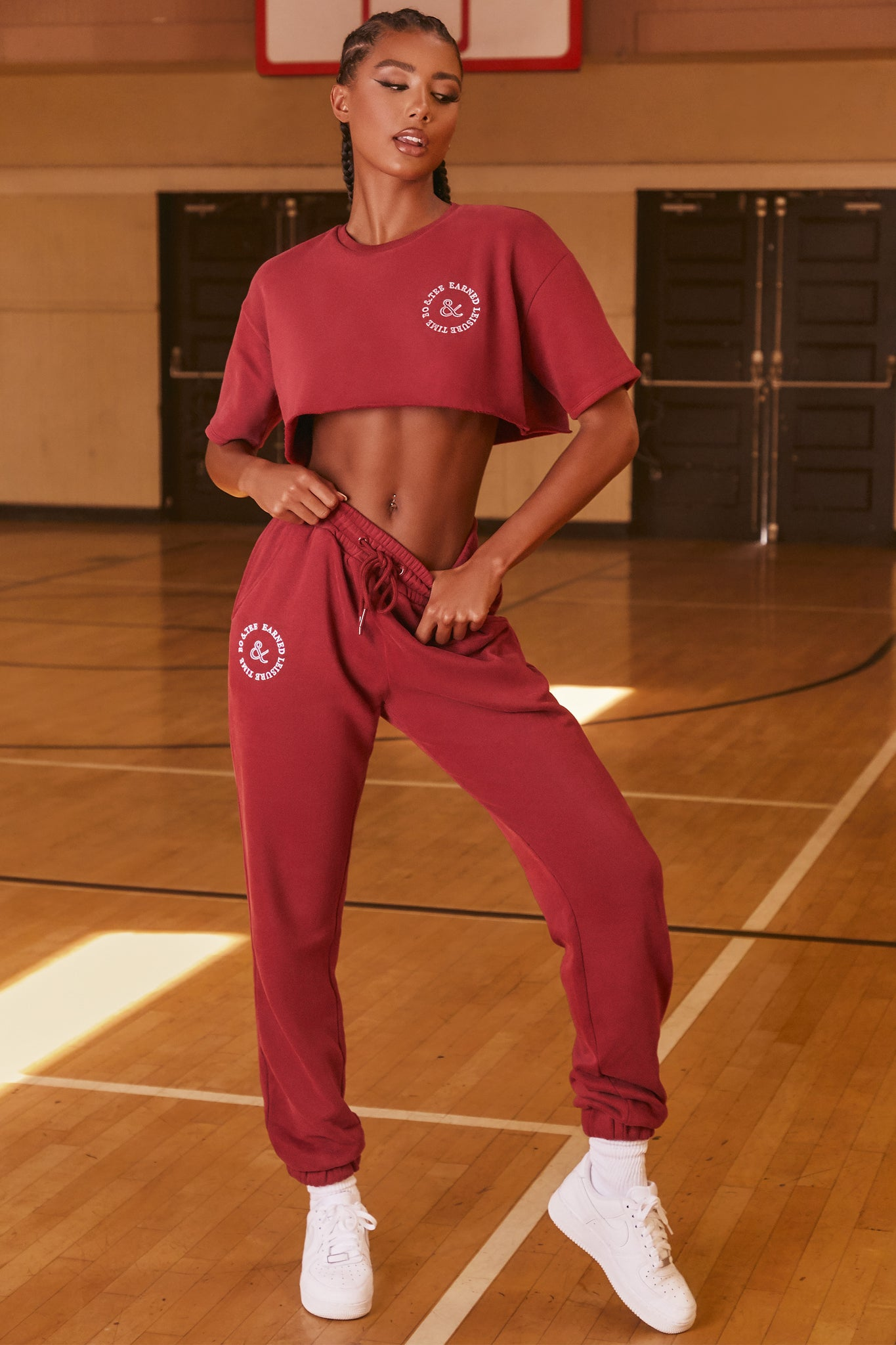 Burgundy full length cuffed joggers with logo branding. Image 1 of 6.