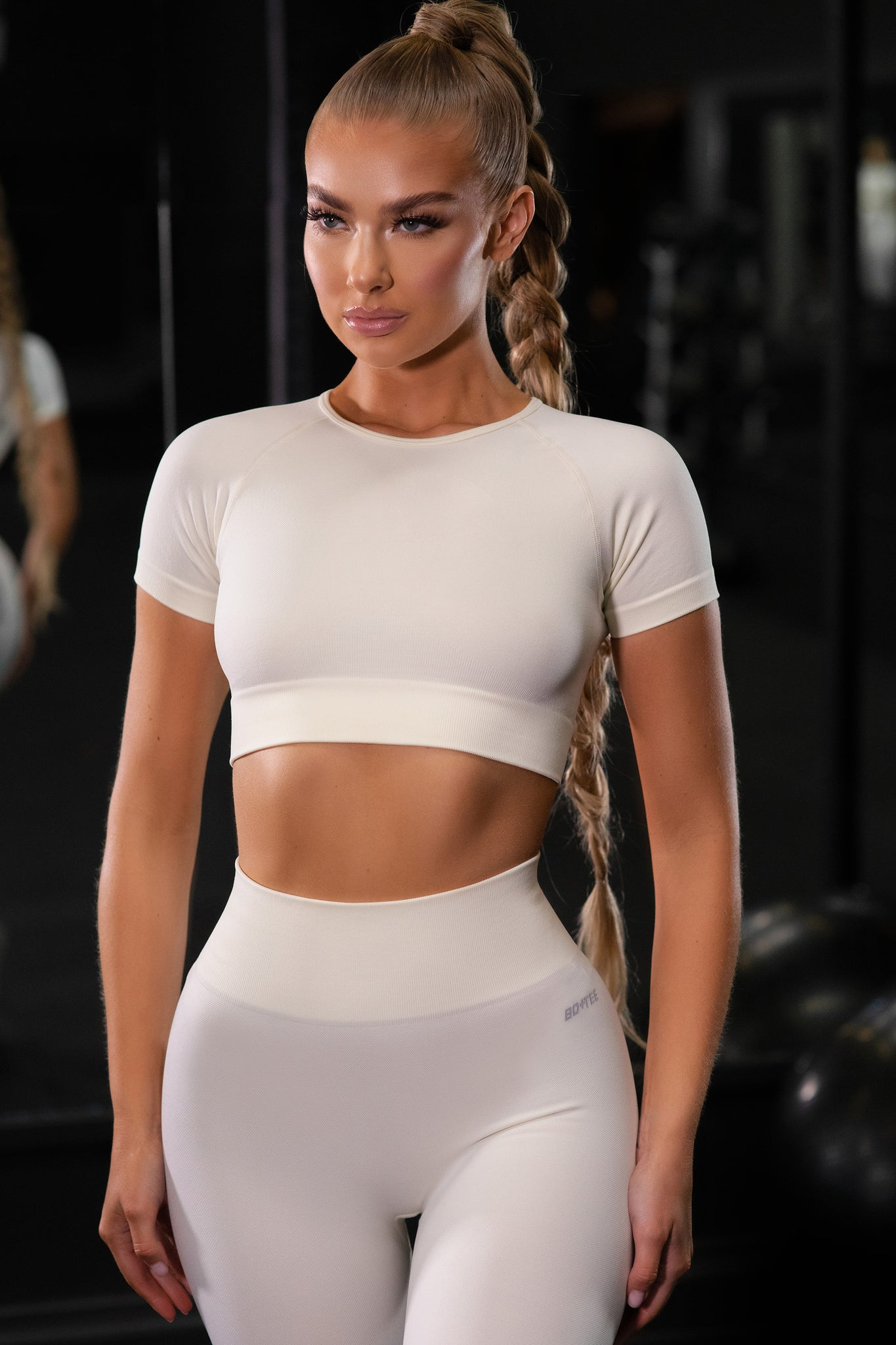 Plain cream seamless short sleeve crop top with ribbed underband and round neck. Image 1 of 6.
