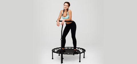 women exercising on a black trampoline